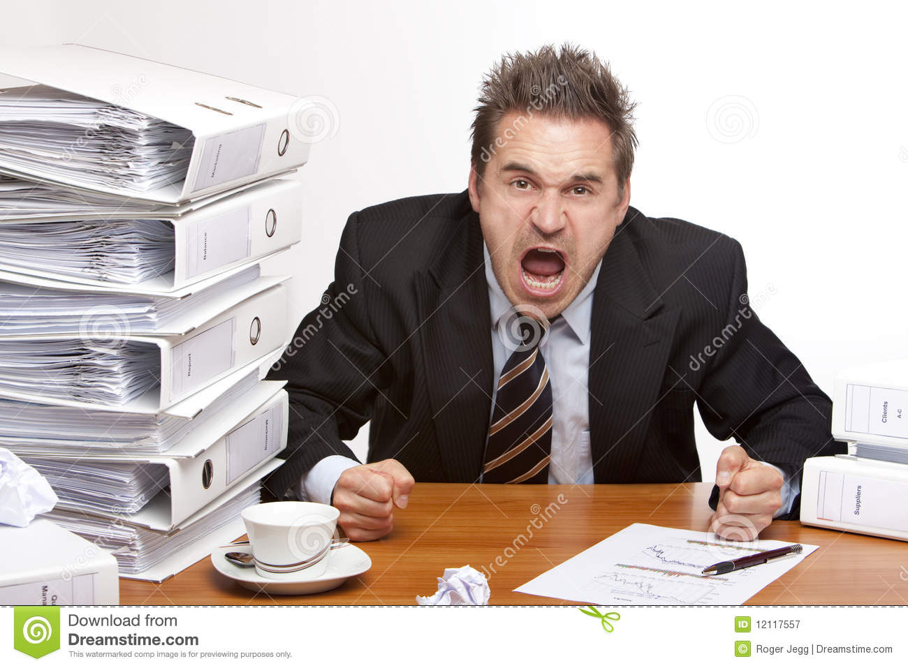 Stressed business man screams frustrated in office