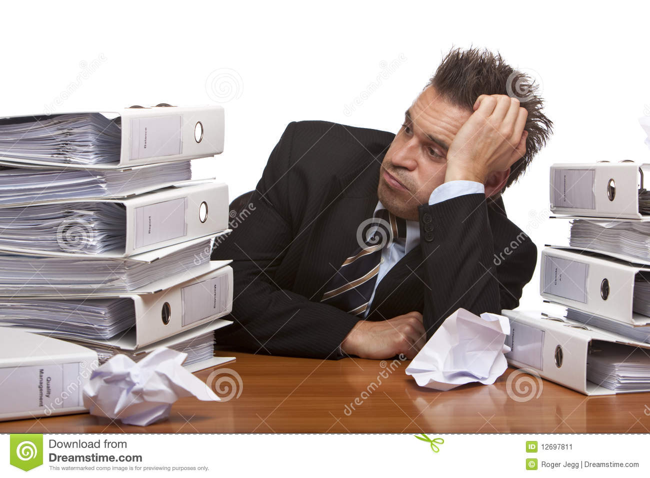 stressed business man sitting frustrated in office stock