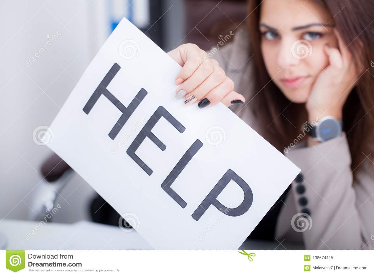Stressed business woman imploring for help, holding a cardboard