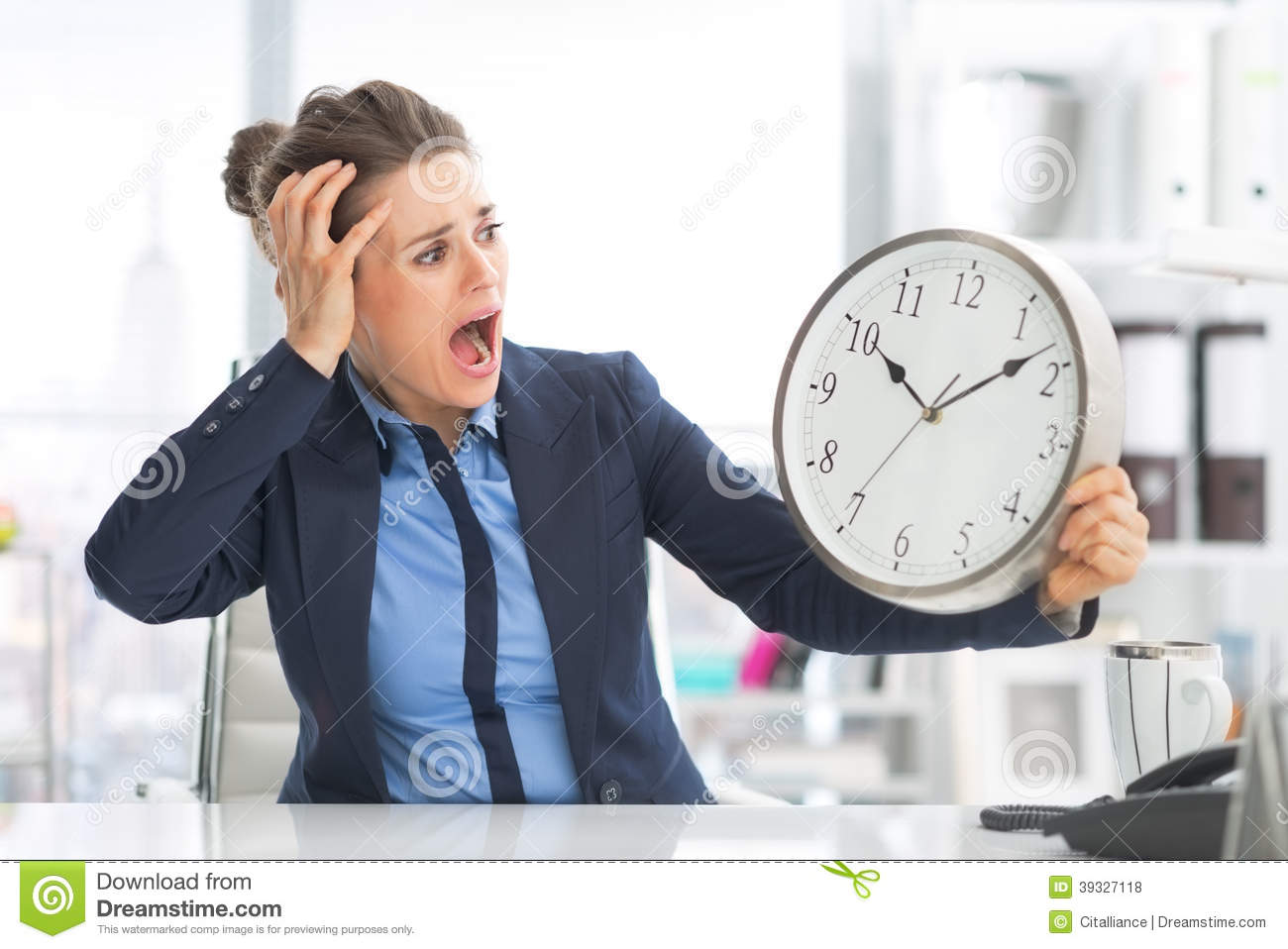 stressed business woman looking on clock stock photo image of