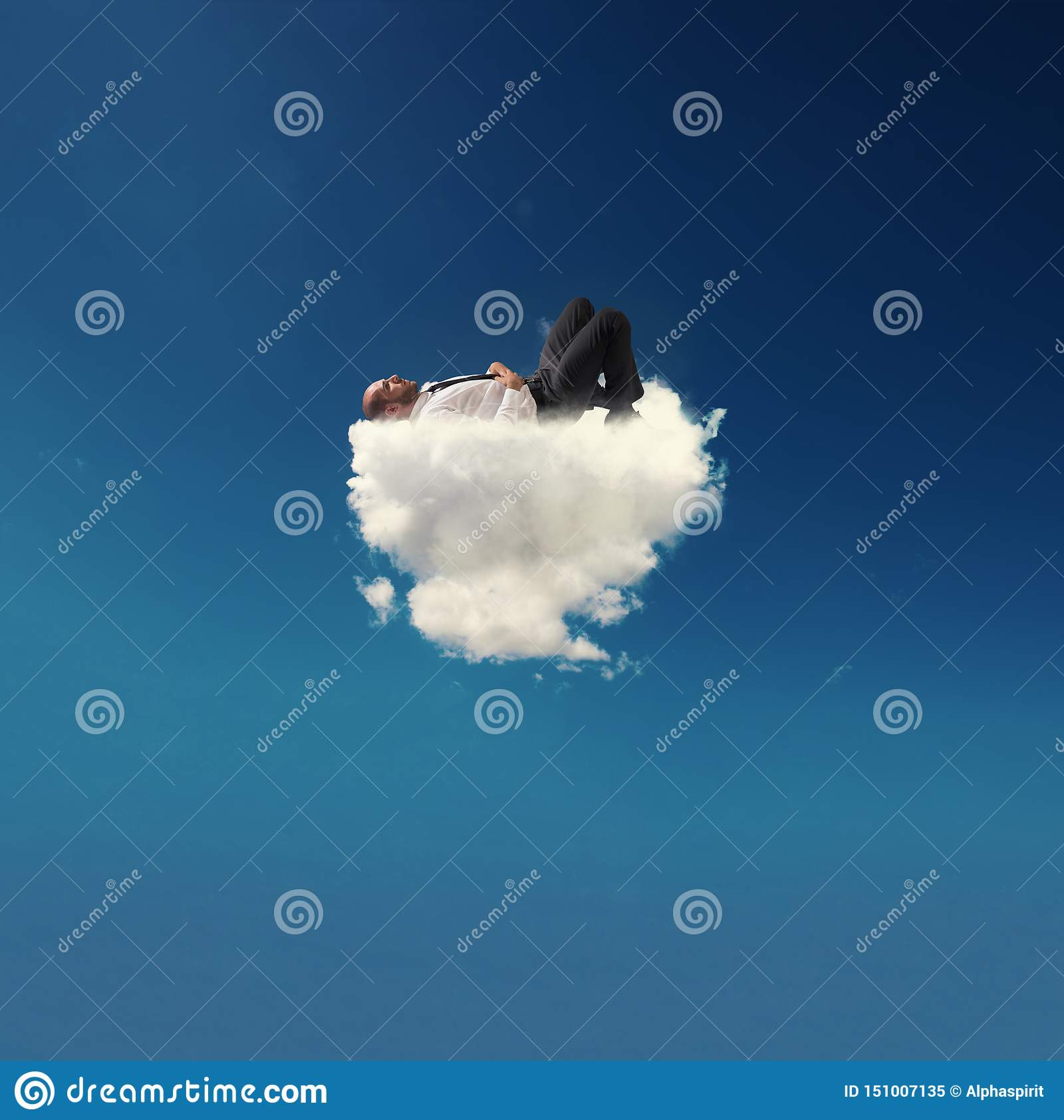Stressed businessman relaxing on a soft cloud