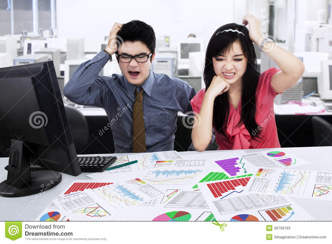 Stressed businessteam analyzing business chart
