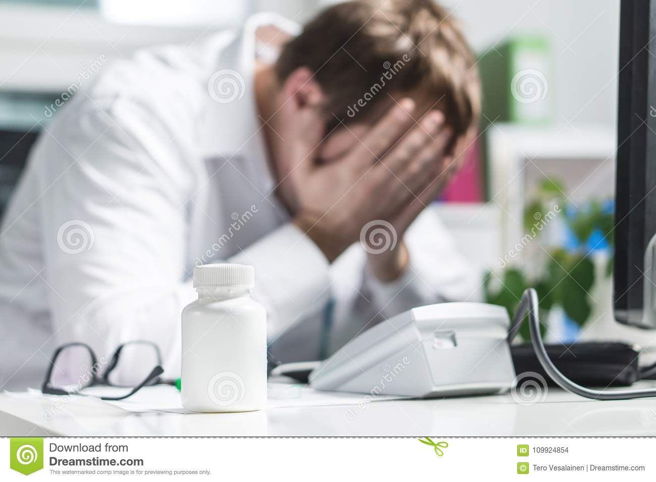 Stressed doctor cover face under pressure.
