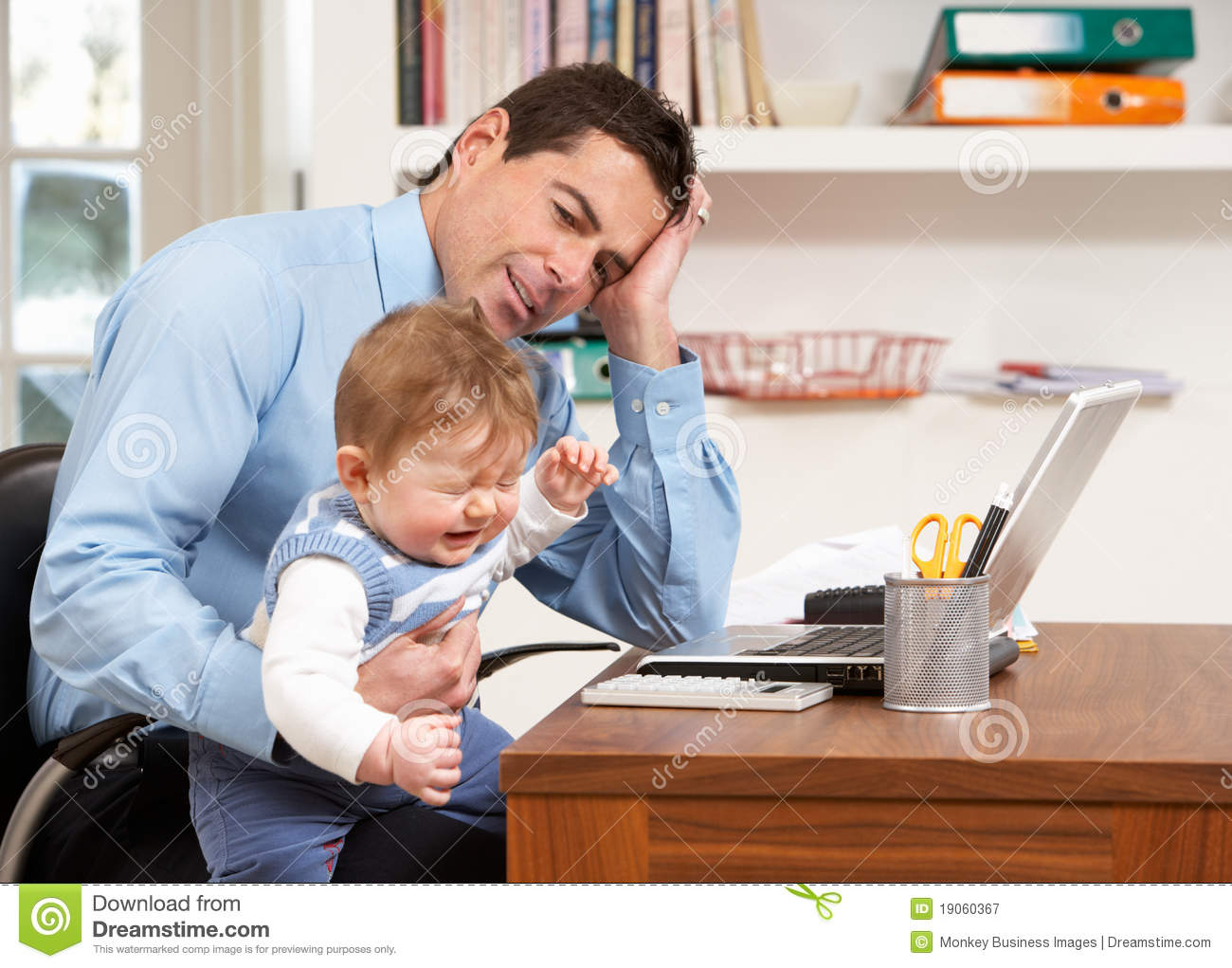 Stressed man with baby working from home royalty free for Work from home pictures