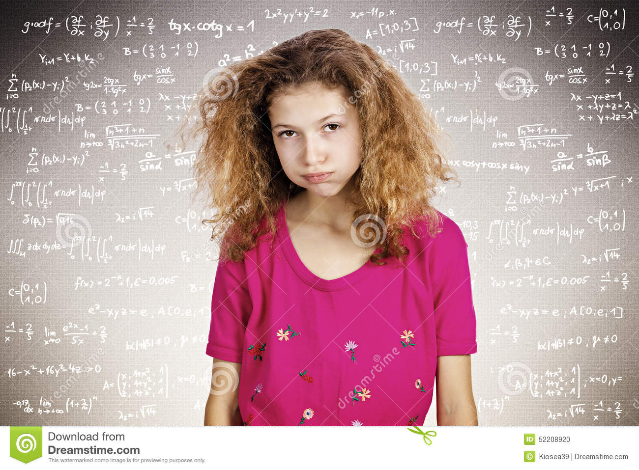 Stressed young student standing in front of a blackboard filled