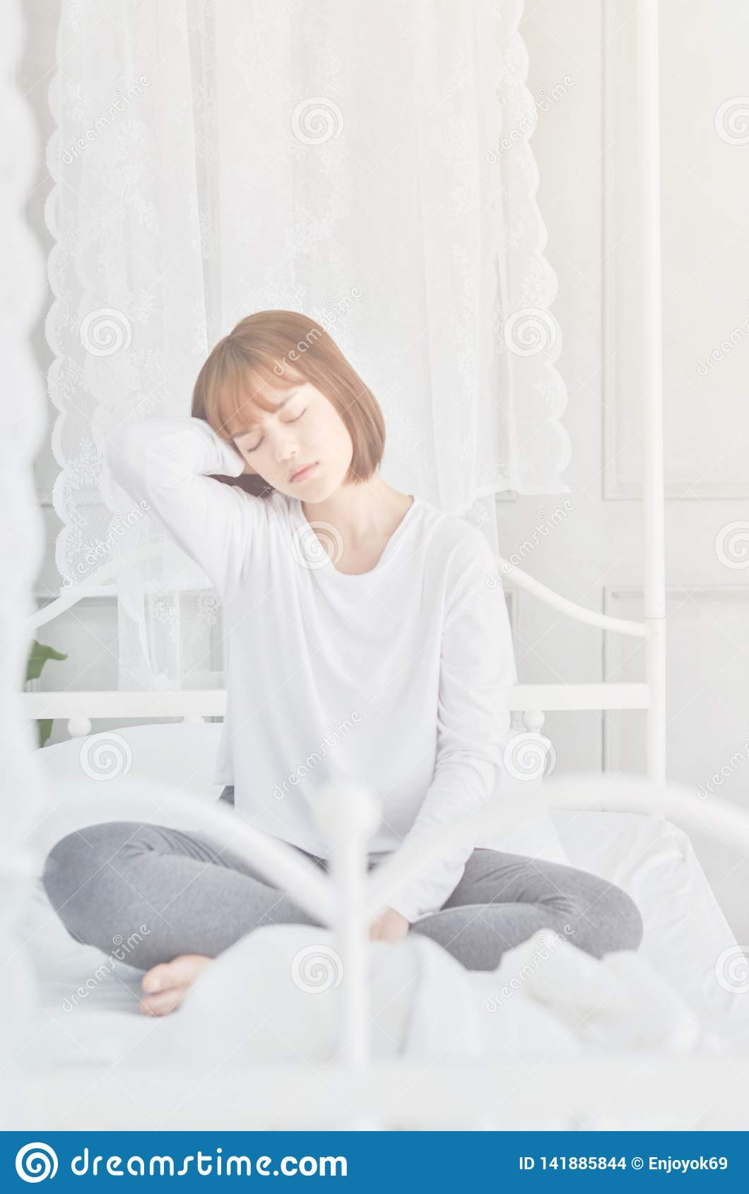 d3594387a05 Women Sit At The Edge Of The Bed. Stock Photo - Image of person ...