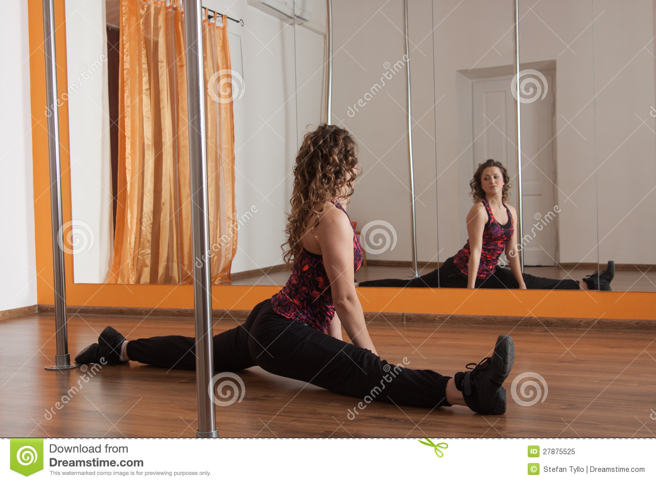 stretching legs  twine before pole dance royalty free