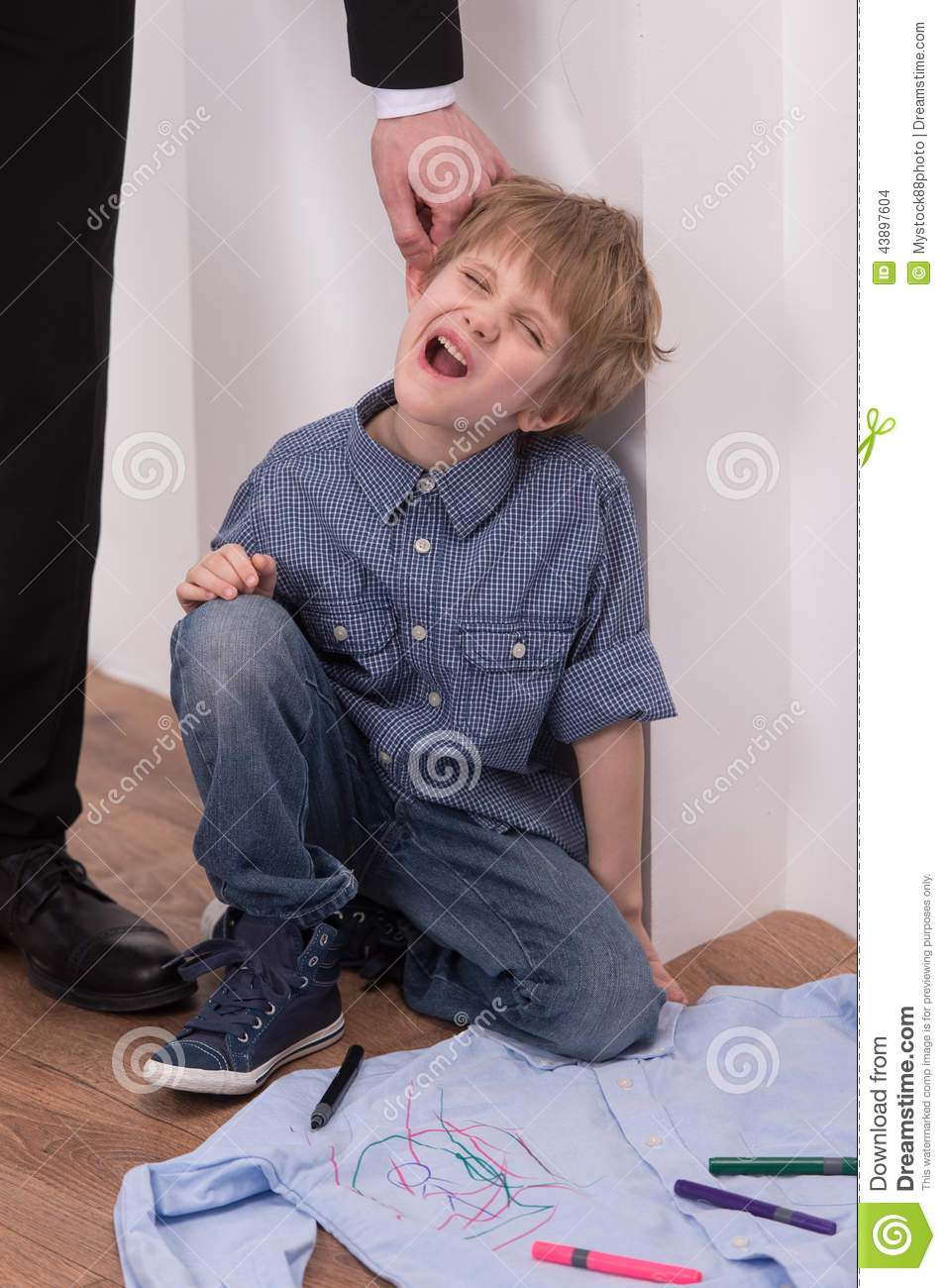 strict father punishes naughty son  stock photo