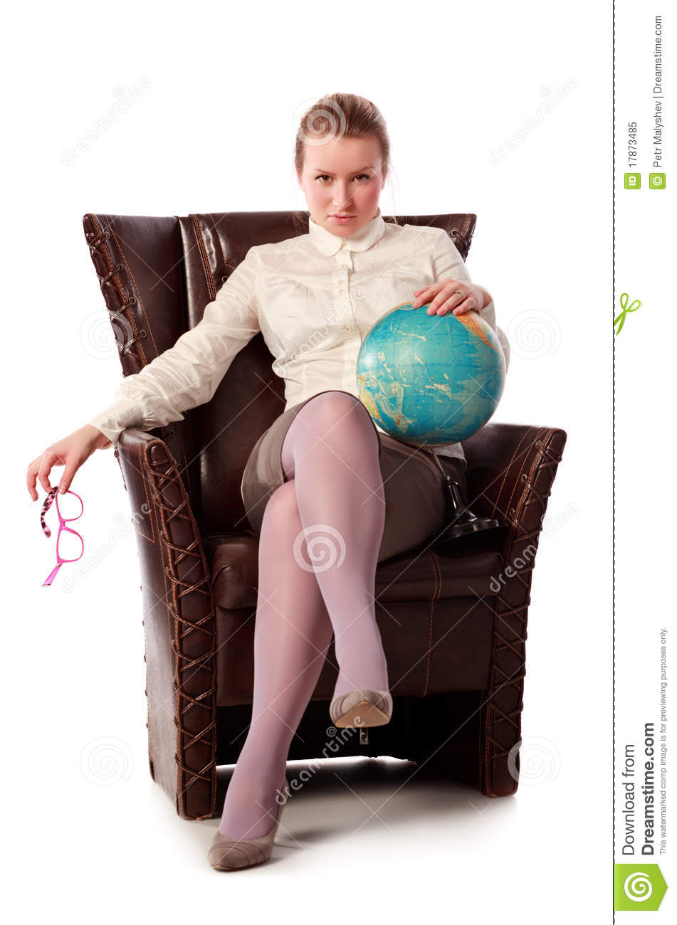 Strict Teacher Sitting In Armchair Royalty Free Stock