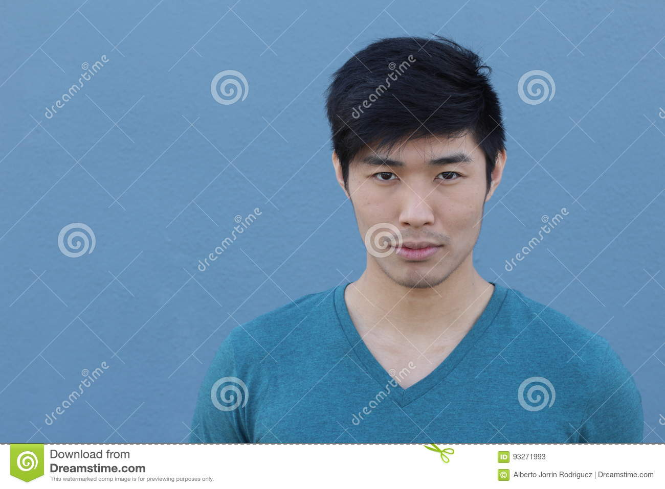 Striking man with neutral expression close up with copy space