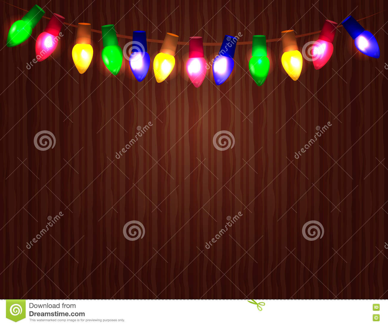 string of color christmas light bulbs on wooden background