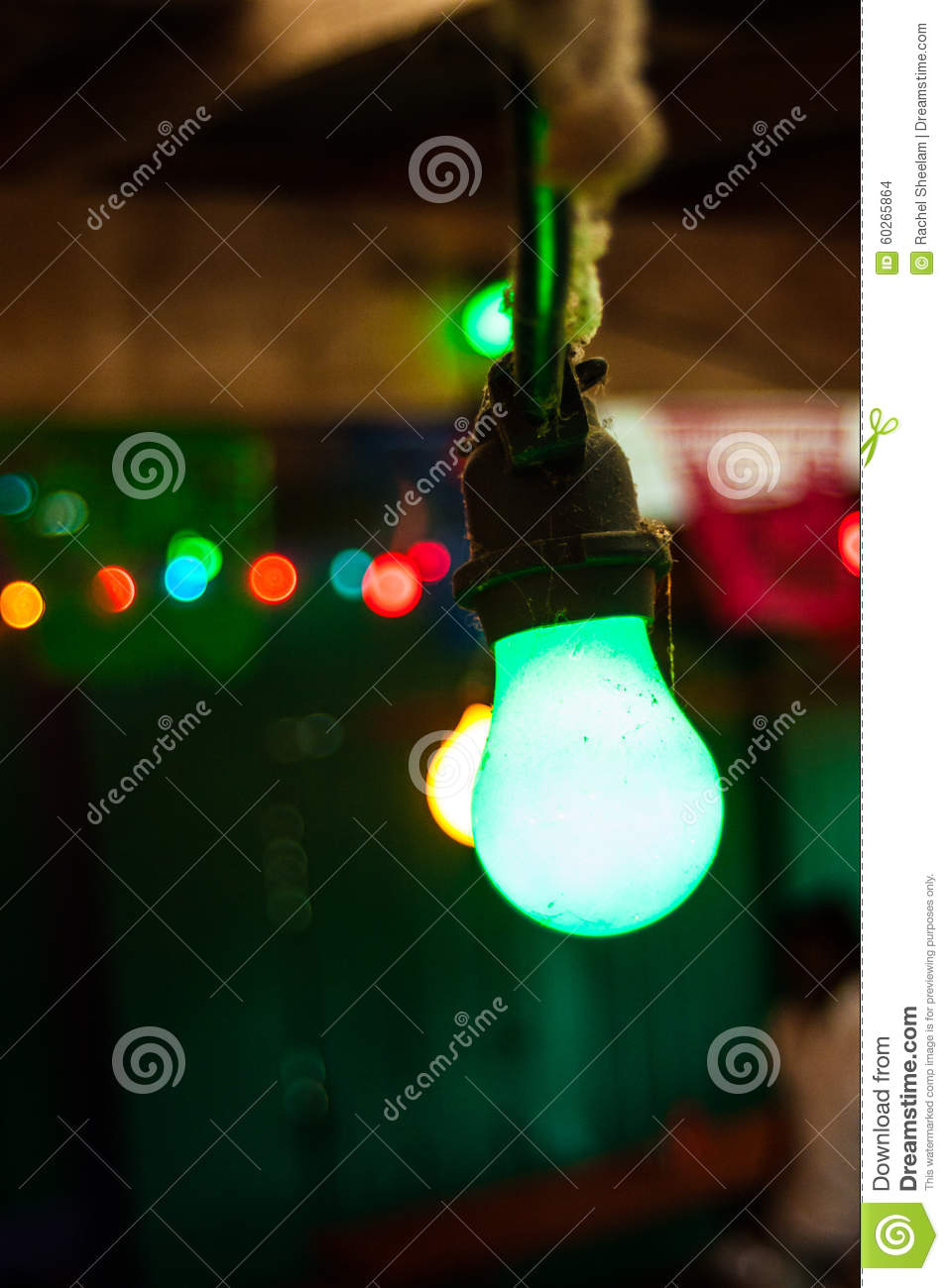 string of colored lights stock photo - Colored Light Bulbs