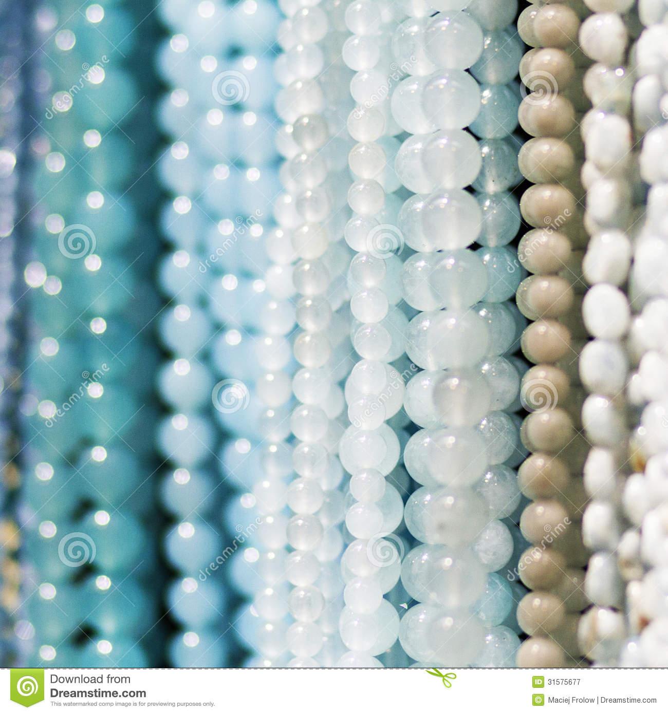 Strings of beads or necklaces