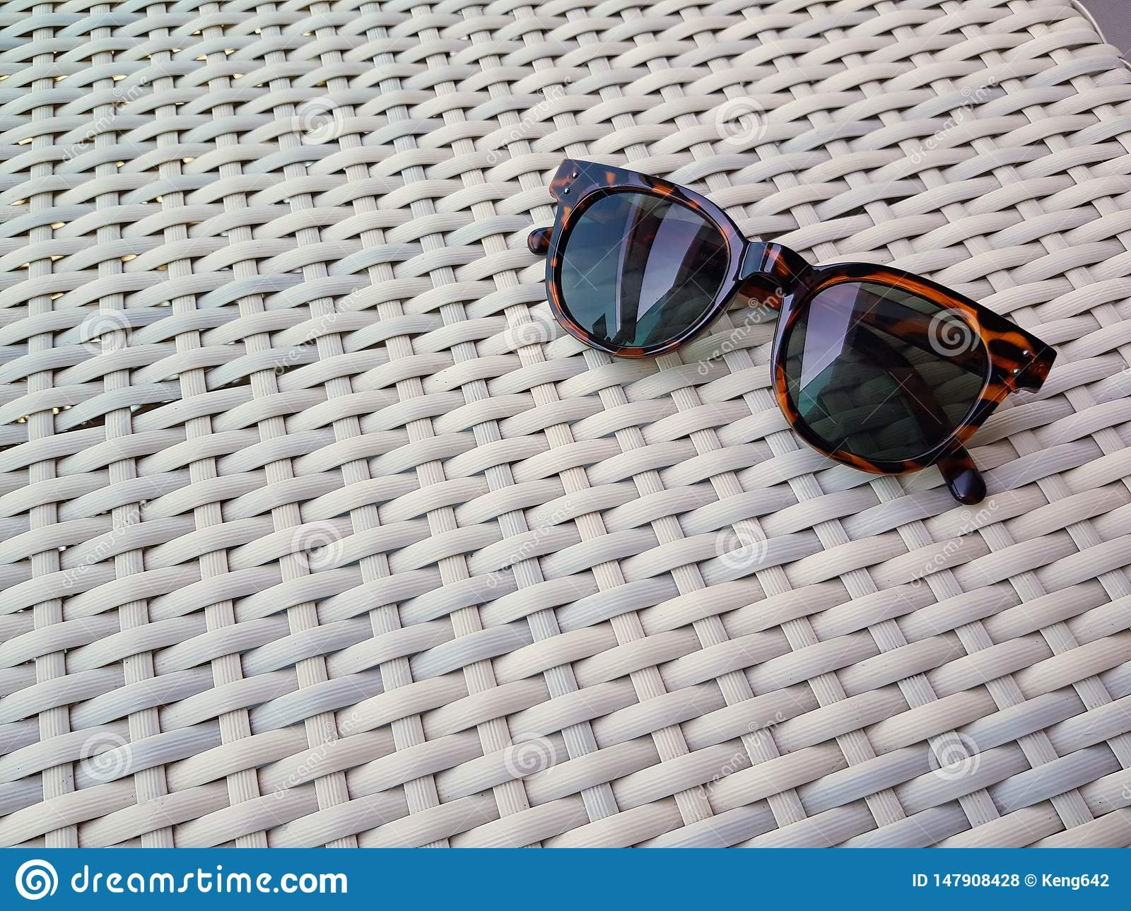 Striped black glasses on the table