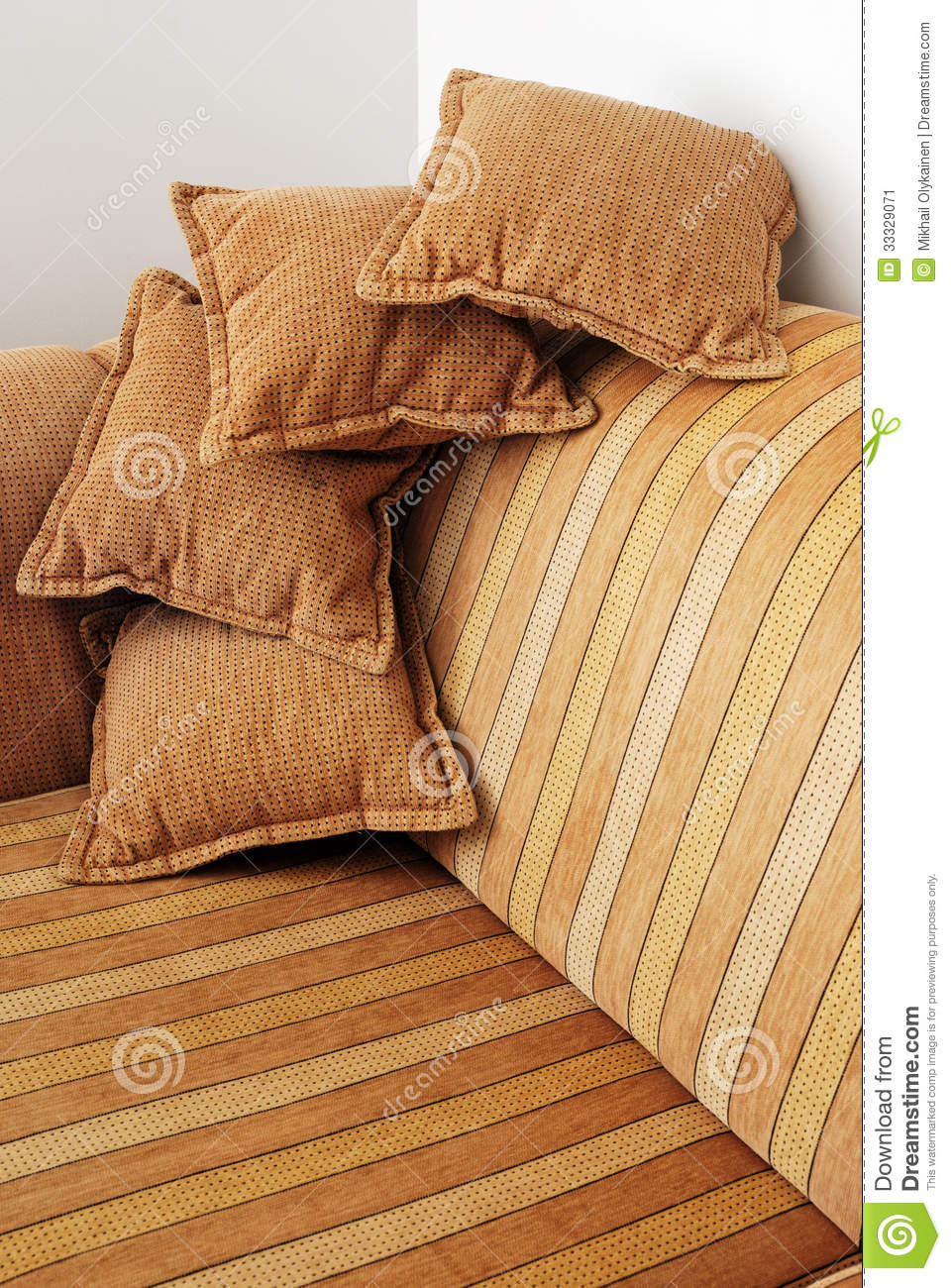 Striped brown sofa and four pillows stock image image 33329071