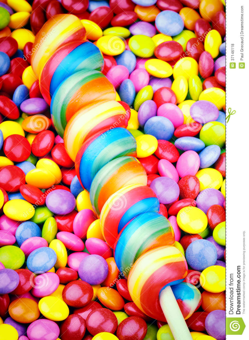 Striped Lollipop And Smarties Royalty Free Stock Photos - Image ...