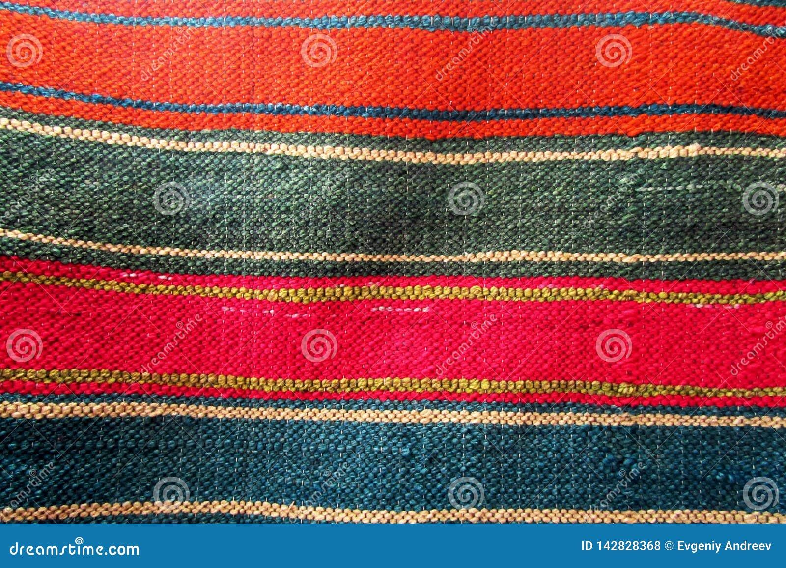 Striped, multicolored carpet.
