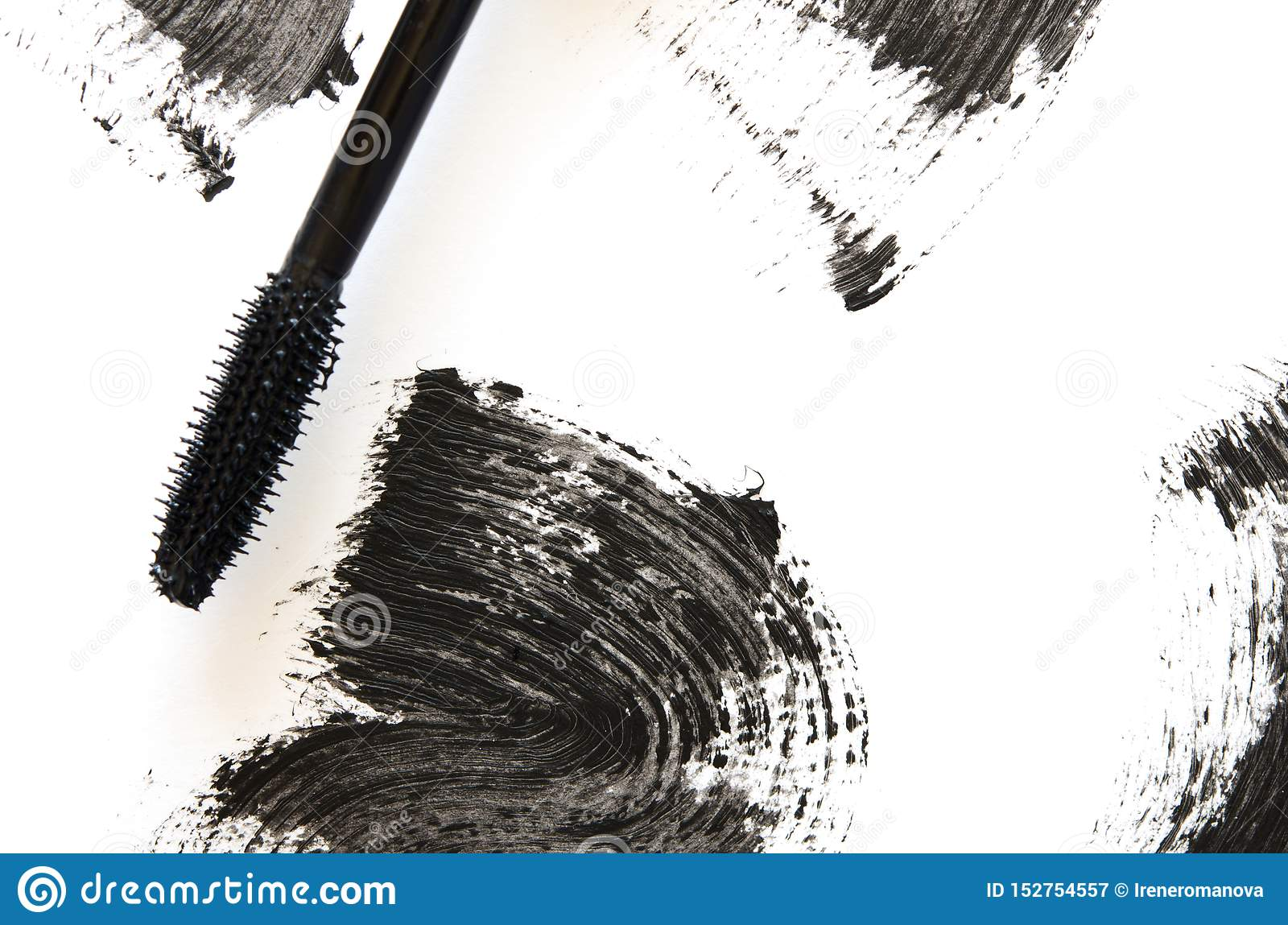 Stroke of black mascara with applicator brush close-up, isolated on white background.