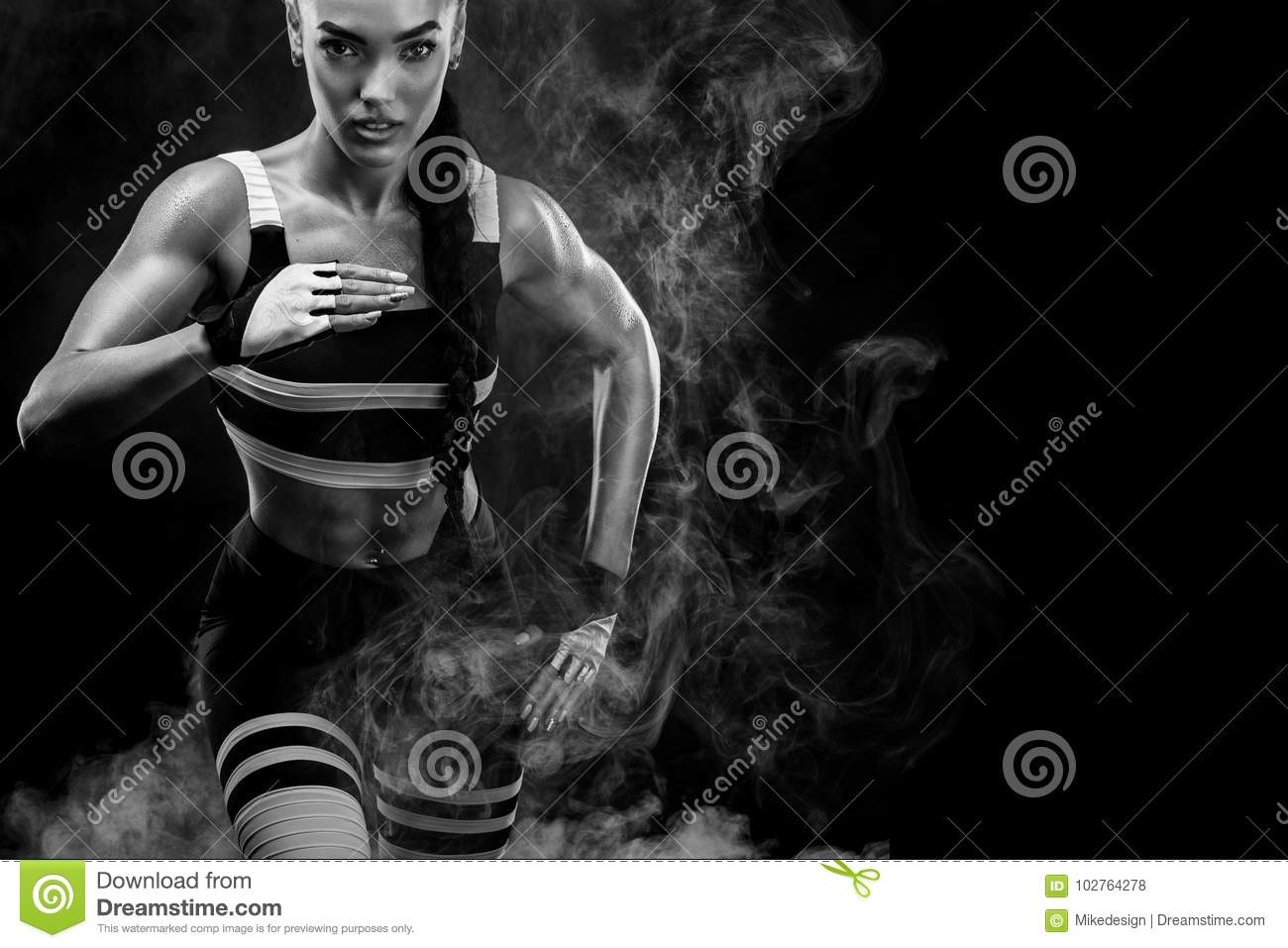 A strong athletic, female sprinter, running at sunrise wearing in the sportswear, fitness and sport motivation concept