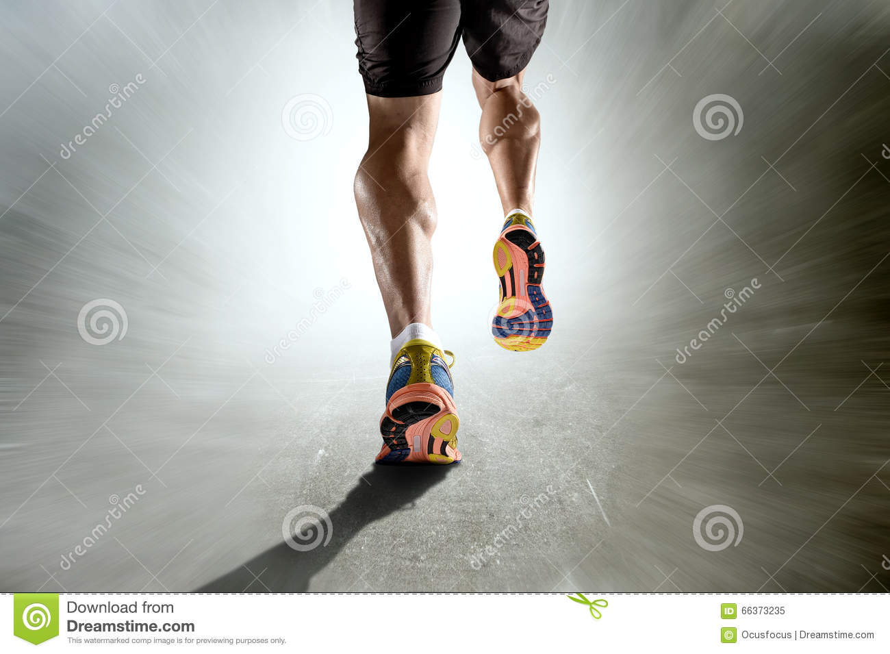 Strong athletic legs with ripped calf muscle of sport man running on motion grunge background