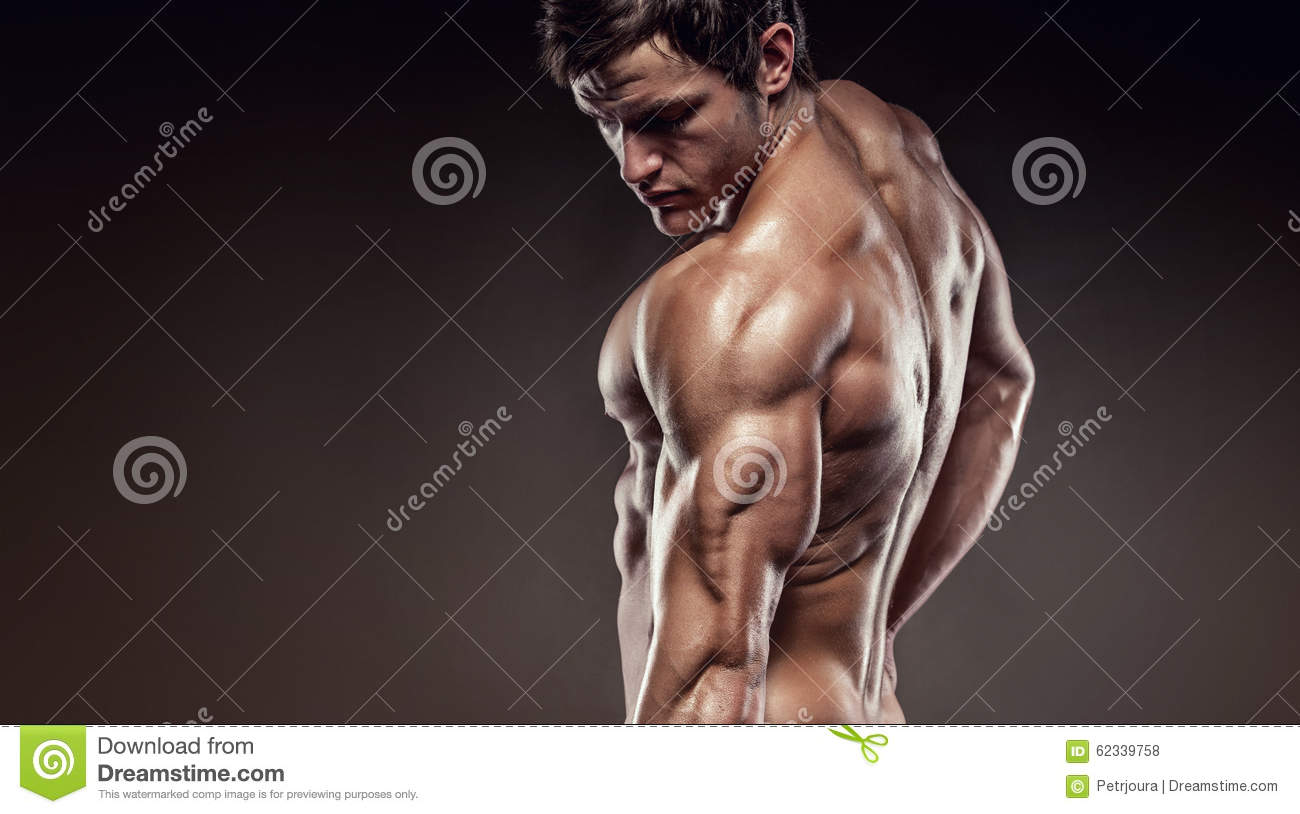 Strong Athletic Man Fitness Model posing back muscles and triceps, copyspace