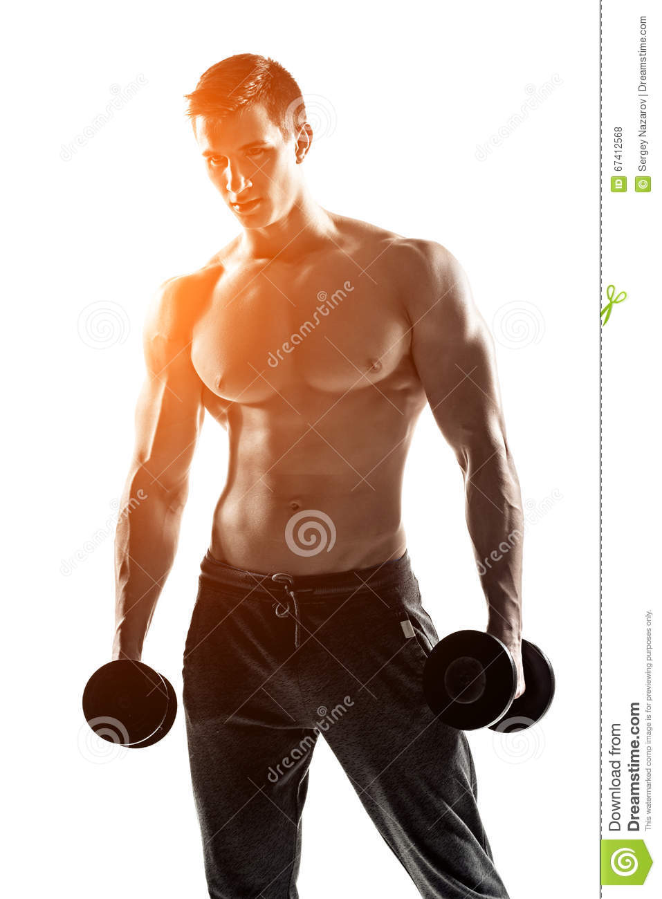 Athletic Man Showing Muscular Body And Doing Exercises