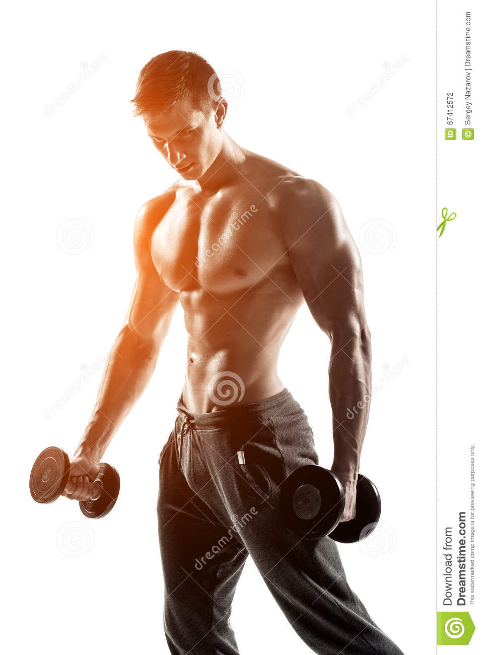 Strong Athletic Man Showing Muscular Body With Dumbbells
