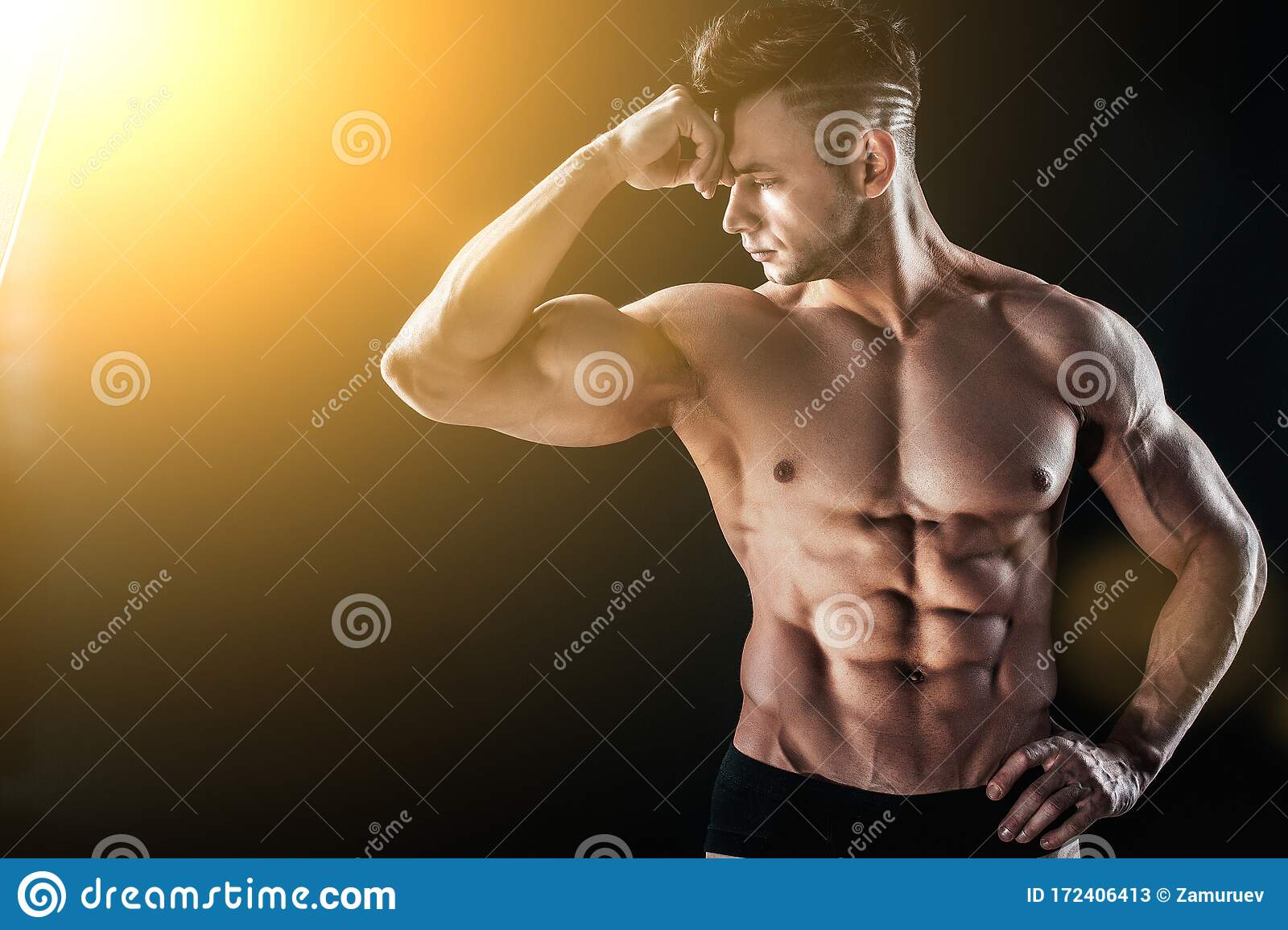 Muscular Man Showing Back Muscles, Isolated On Black