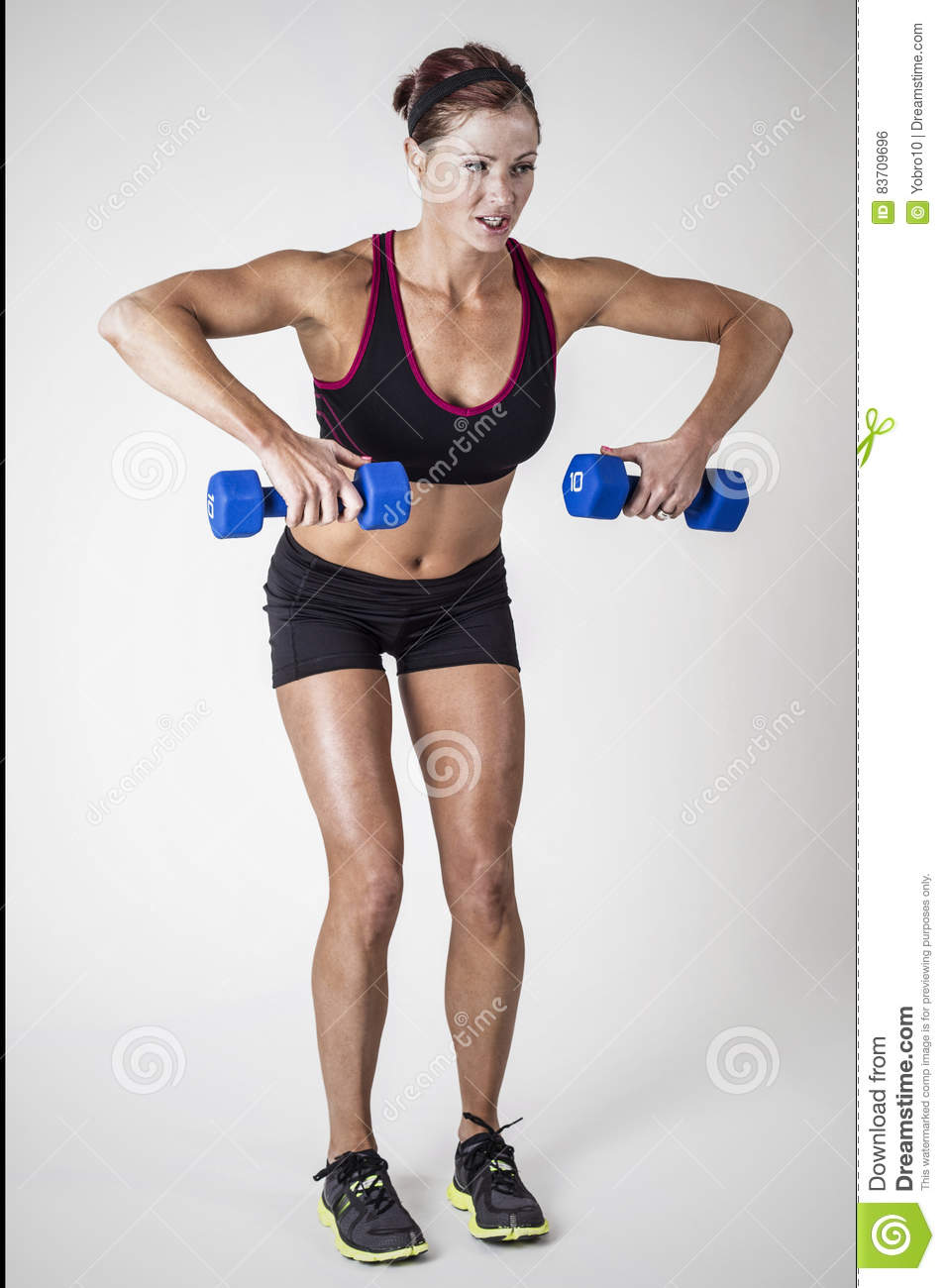 Strong Beautiful Fitness Woman Lifting Dumbbell Weights Stock Photo
