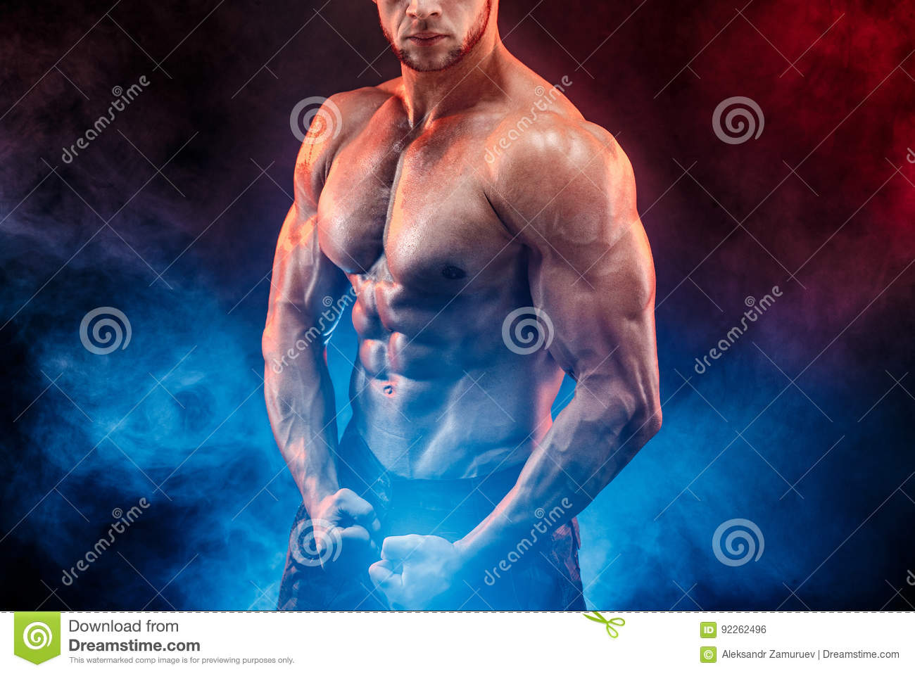 Strong bodybuilder man in military pants with perfect abs, shoulders,biceps, triceps, chest