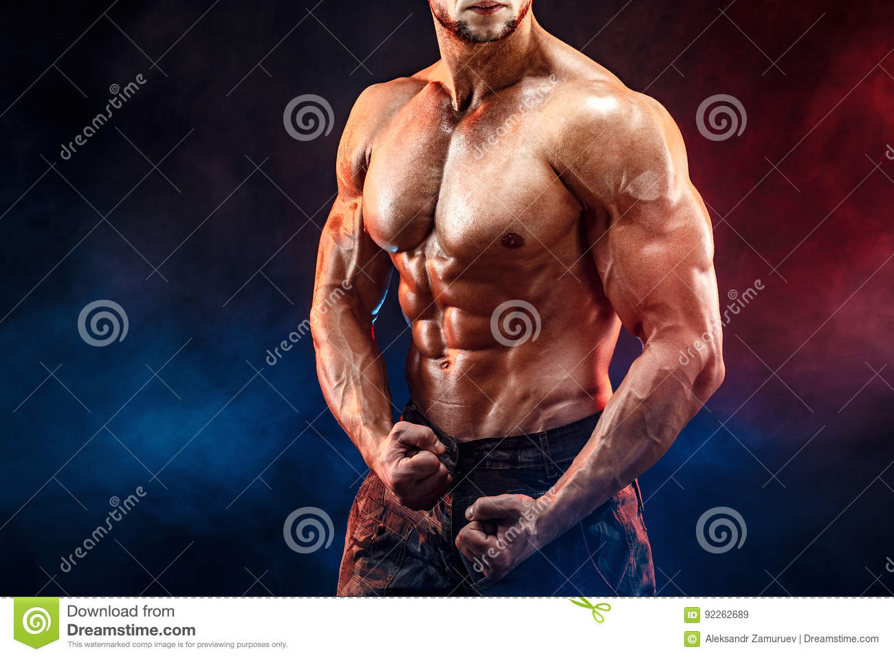 Strong bodybuilder man in military pants with perfect abs, shoulders, biceps, triceps, chest