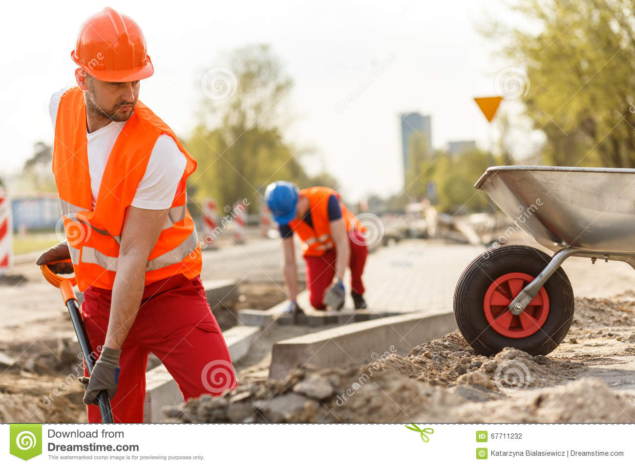 Strong construction worker digging stock photo image for Digging ground dream meaning