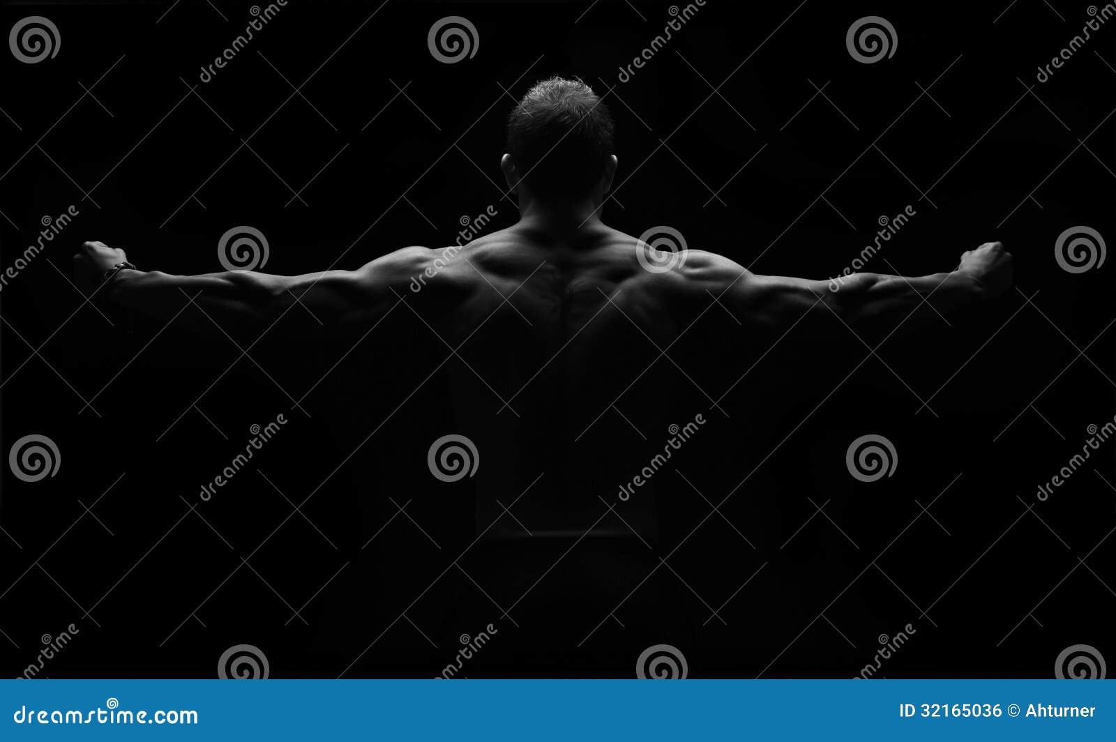 Strong fitness man flexing