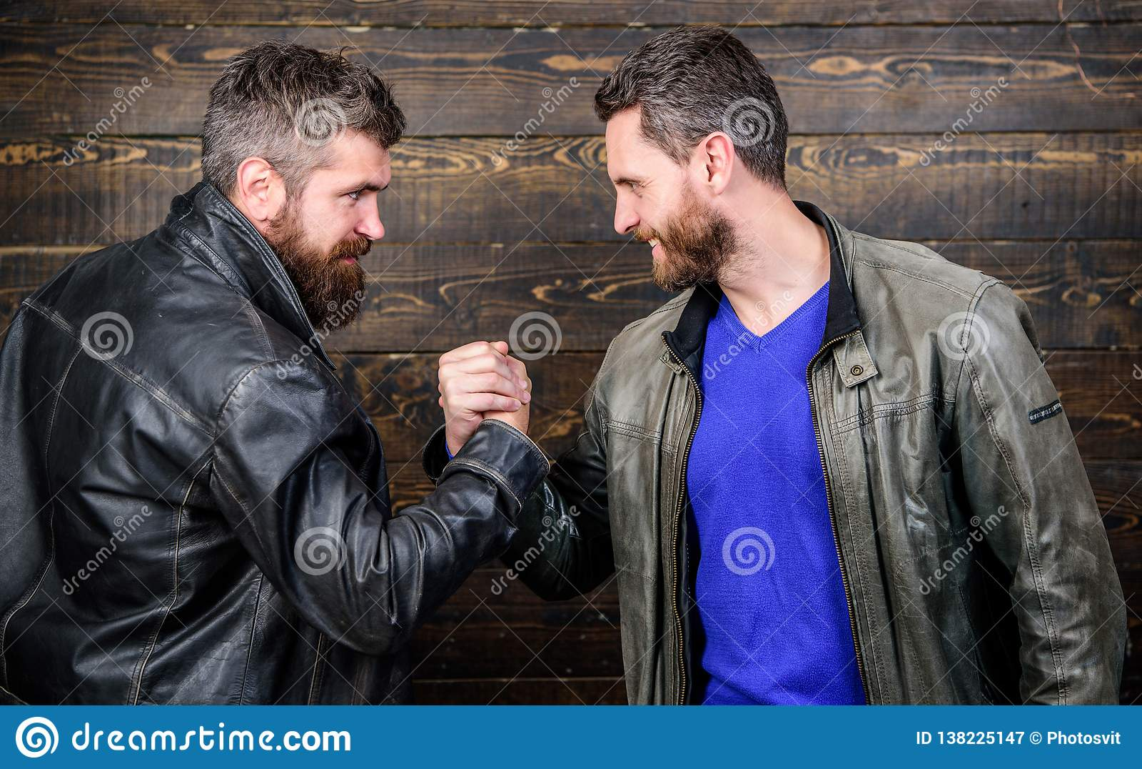 Strong handshake. Friendship of brutal guys. Handshake symbol of successful deal. Approved business deal. Handshake