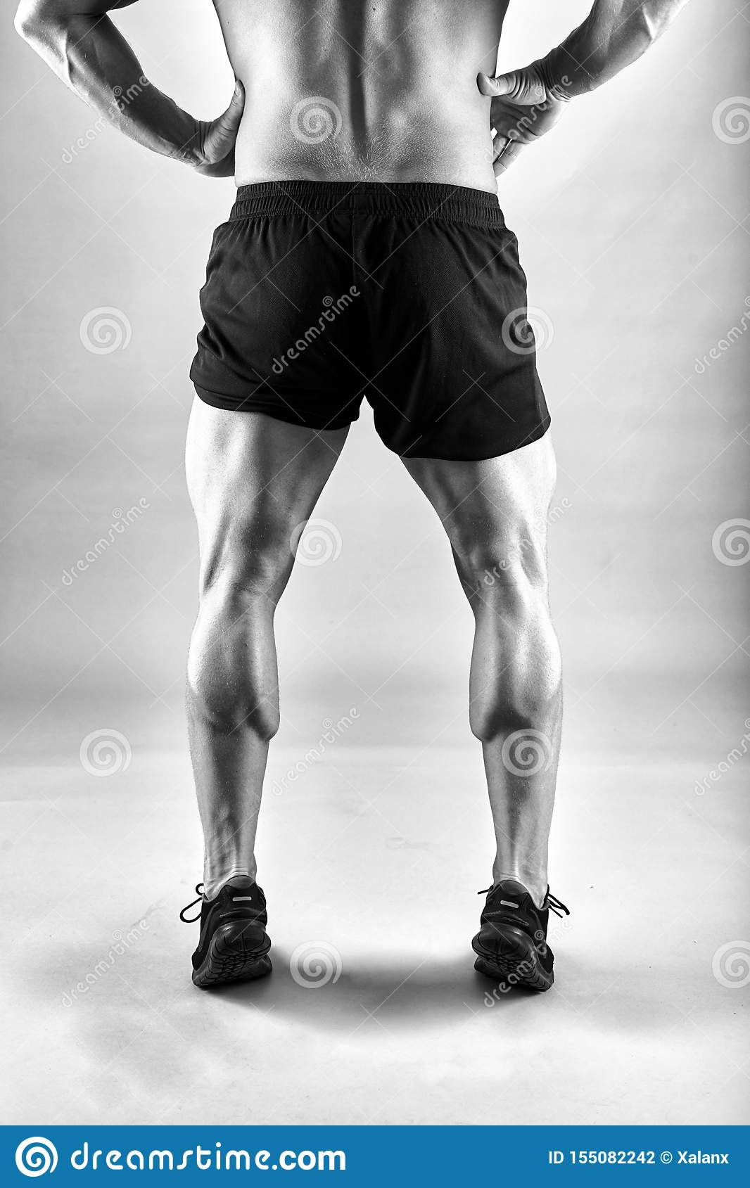 Strong male legs stock photo. Image of athlete, muscles