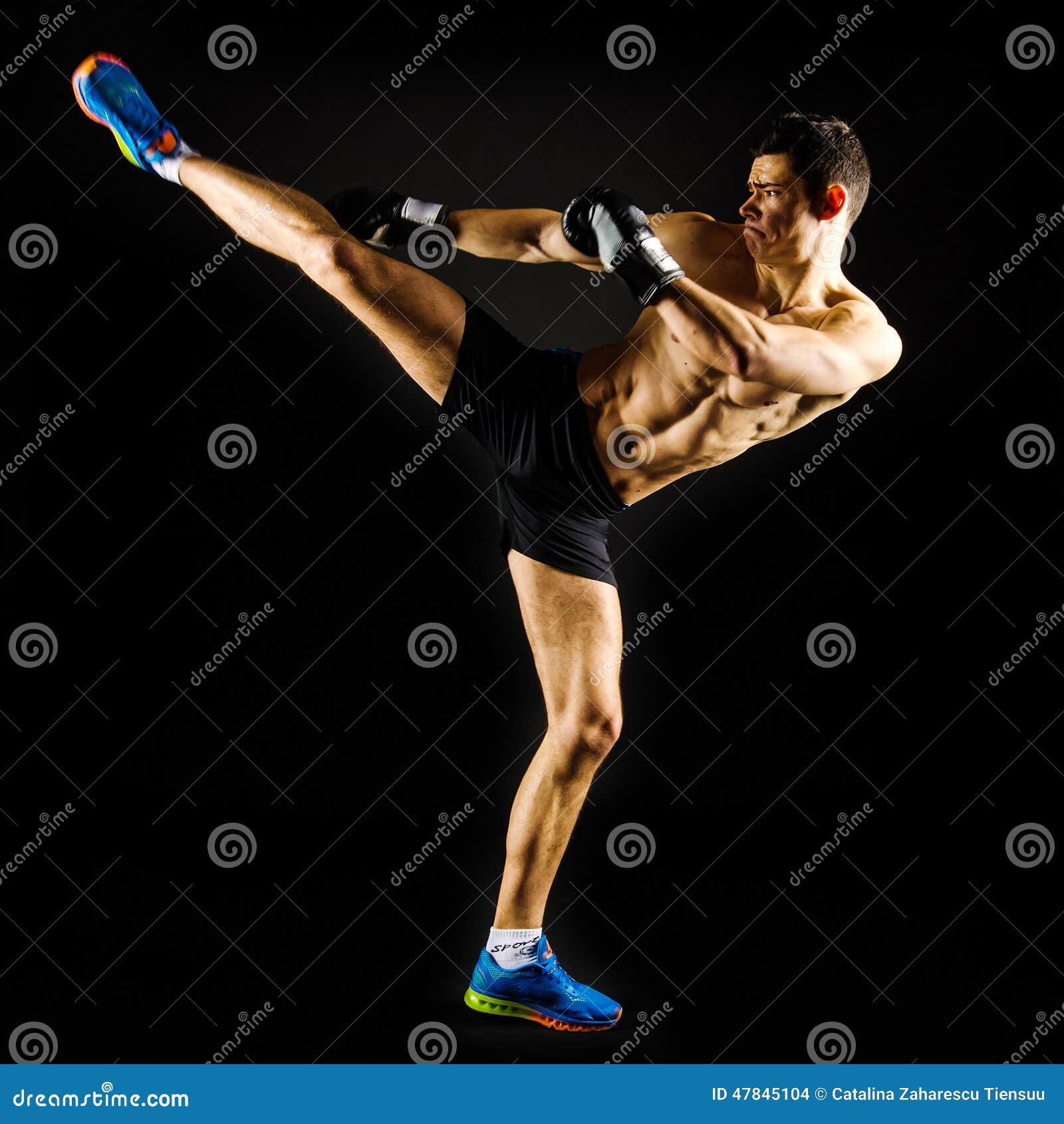 Strong man doing a high kick