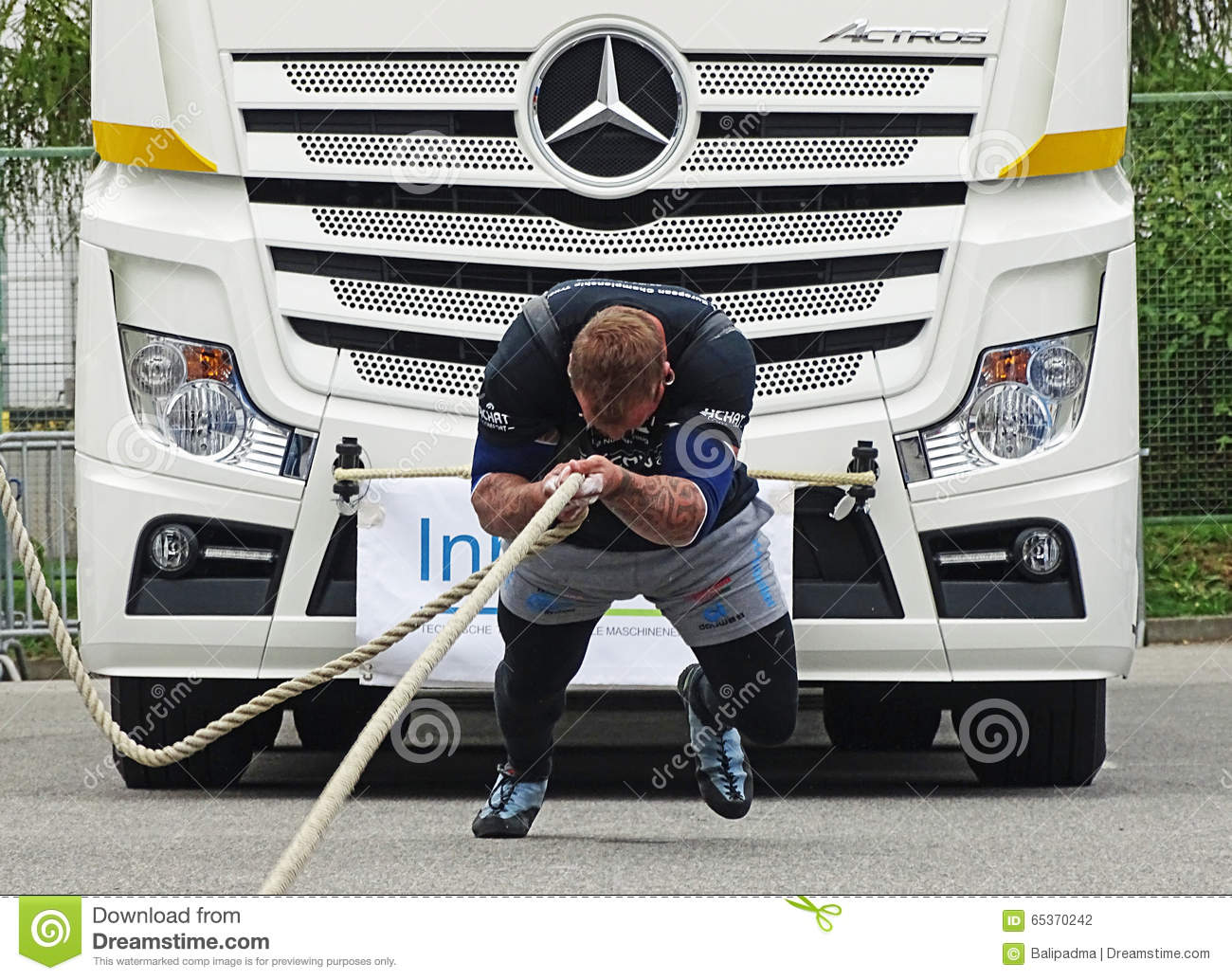 a strong man pulls a big truck editorial photography strong man clipart black and white strong man clipart images