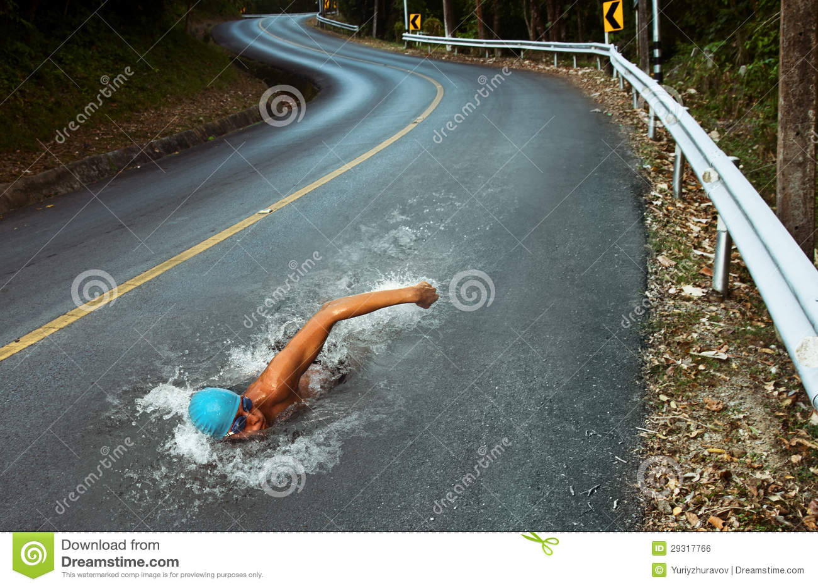 Strong Man Swim On Asphalt Road