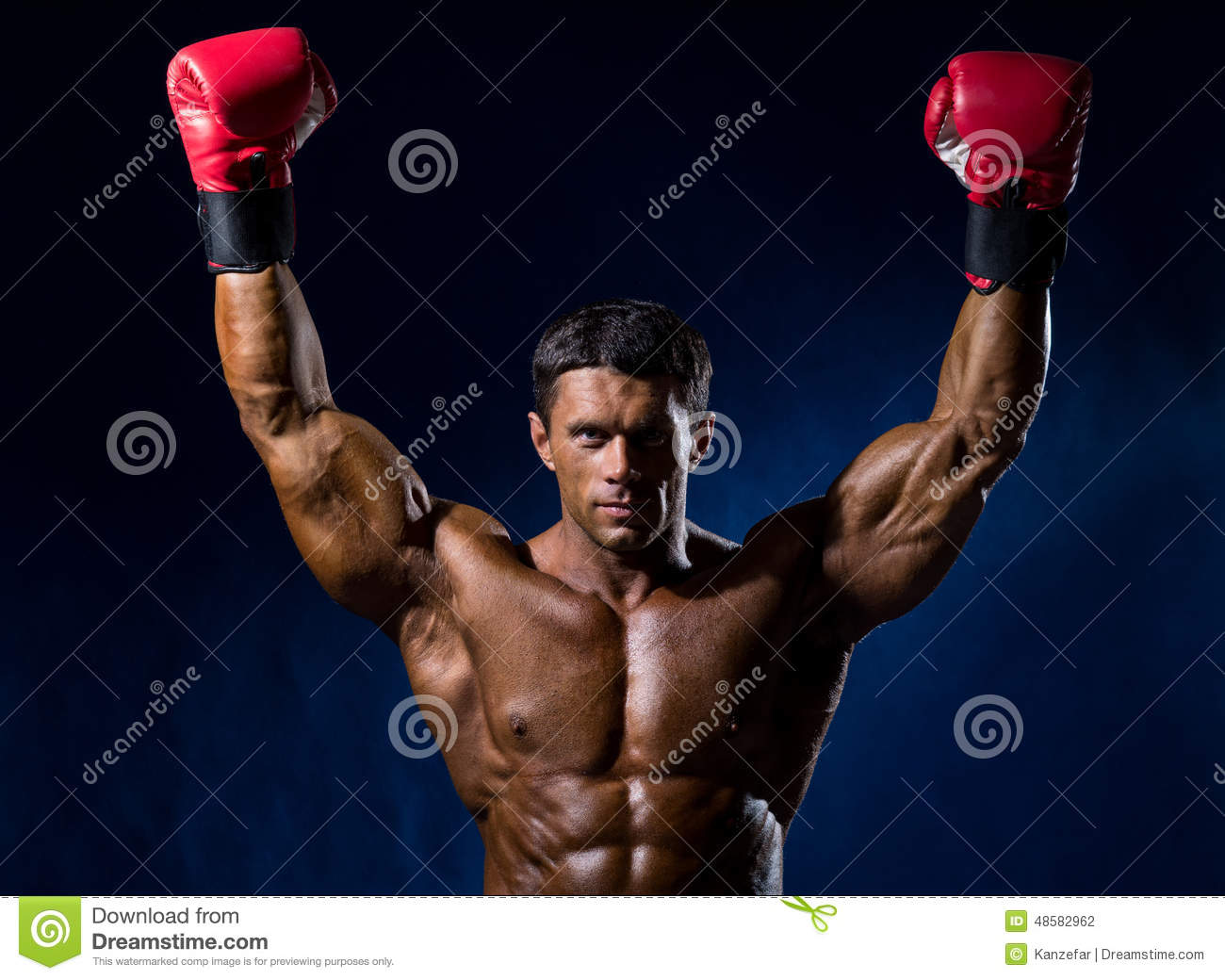 Strong Muscular Boxer In Red Boxing Gloves Raised His