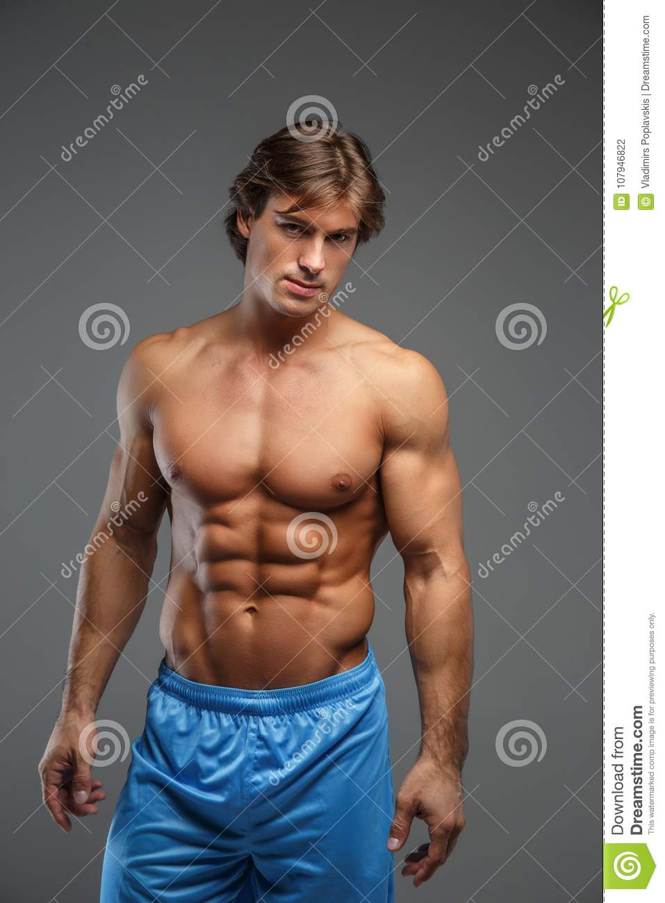 f7d250e2ec5 Strong Muscular Man In Blue Shorts. Stock Photo - Image of caucasian ...