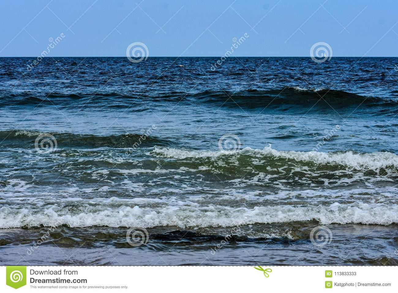 Strong Ocean Waves Rolling Into The Beach