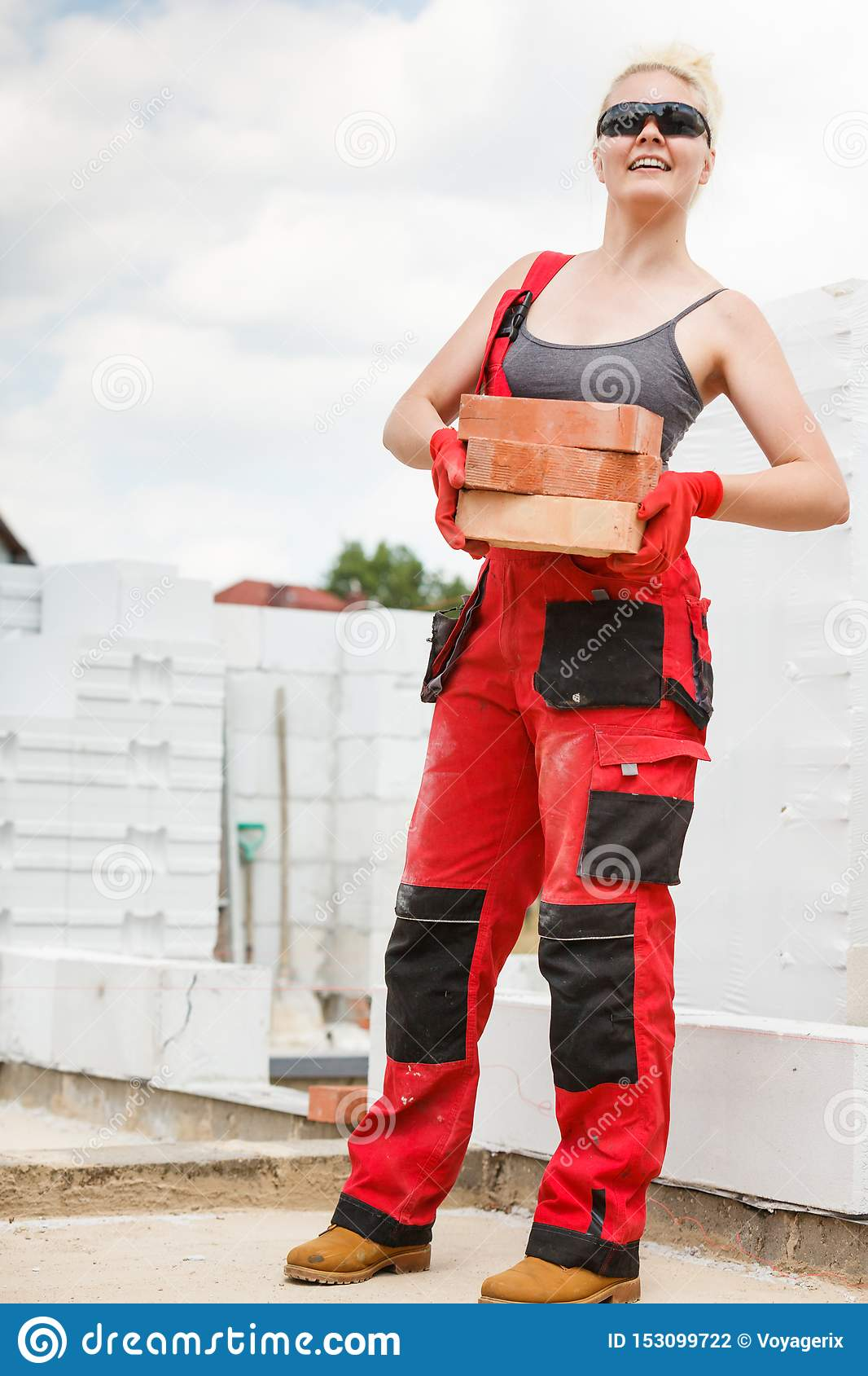 Woman working with bricks