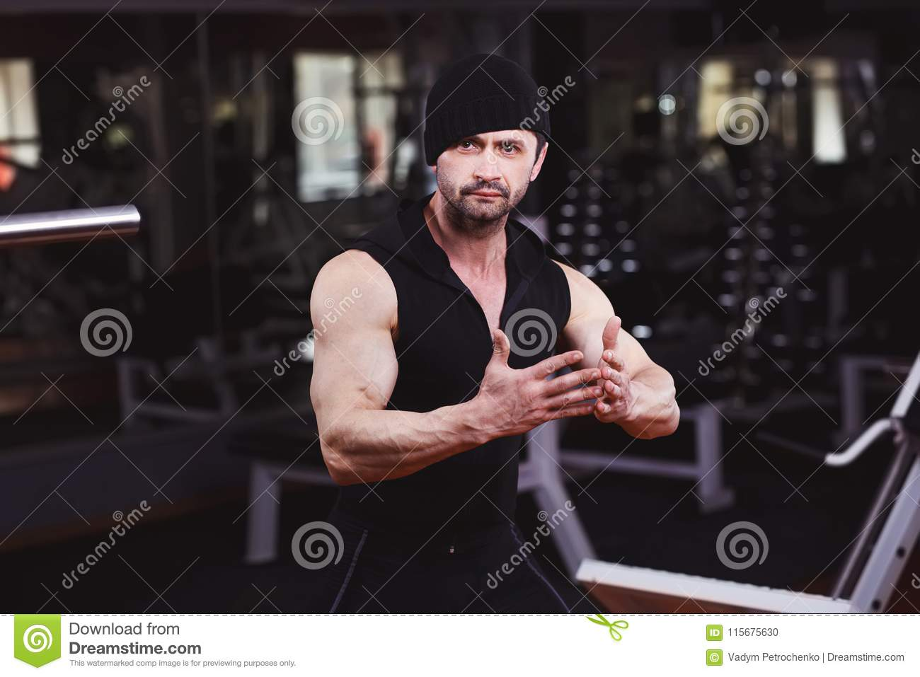 Strong ripped adult man with perfect abs, shoulders, biceps, tri
