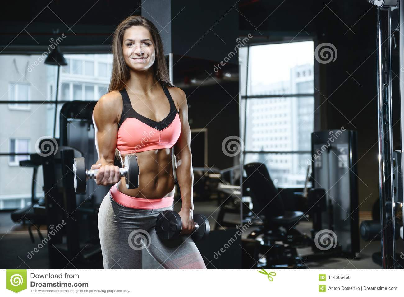 7723aa76b2361 Beautiful strong athletic muscular young caucasian fitness girl workout  training in the gym on diet pumping up abs muscles and posing bodybuilding  health ...