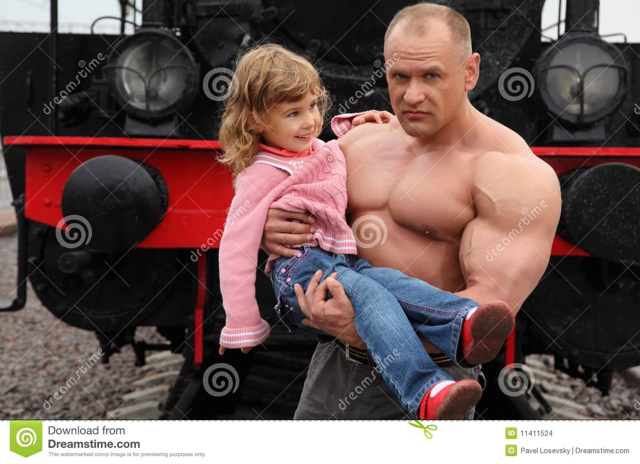 Strong Shirtless Man Sits With Little Girl Stock Image