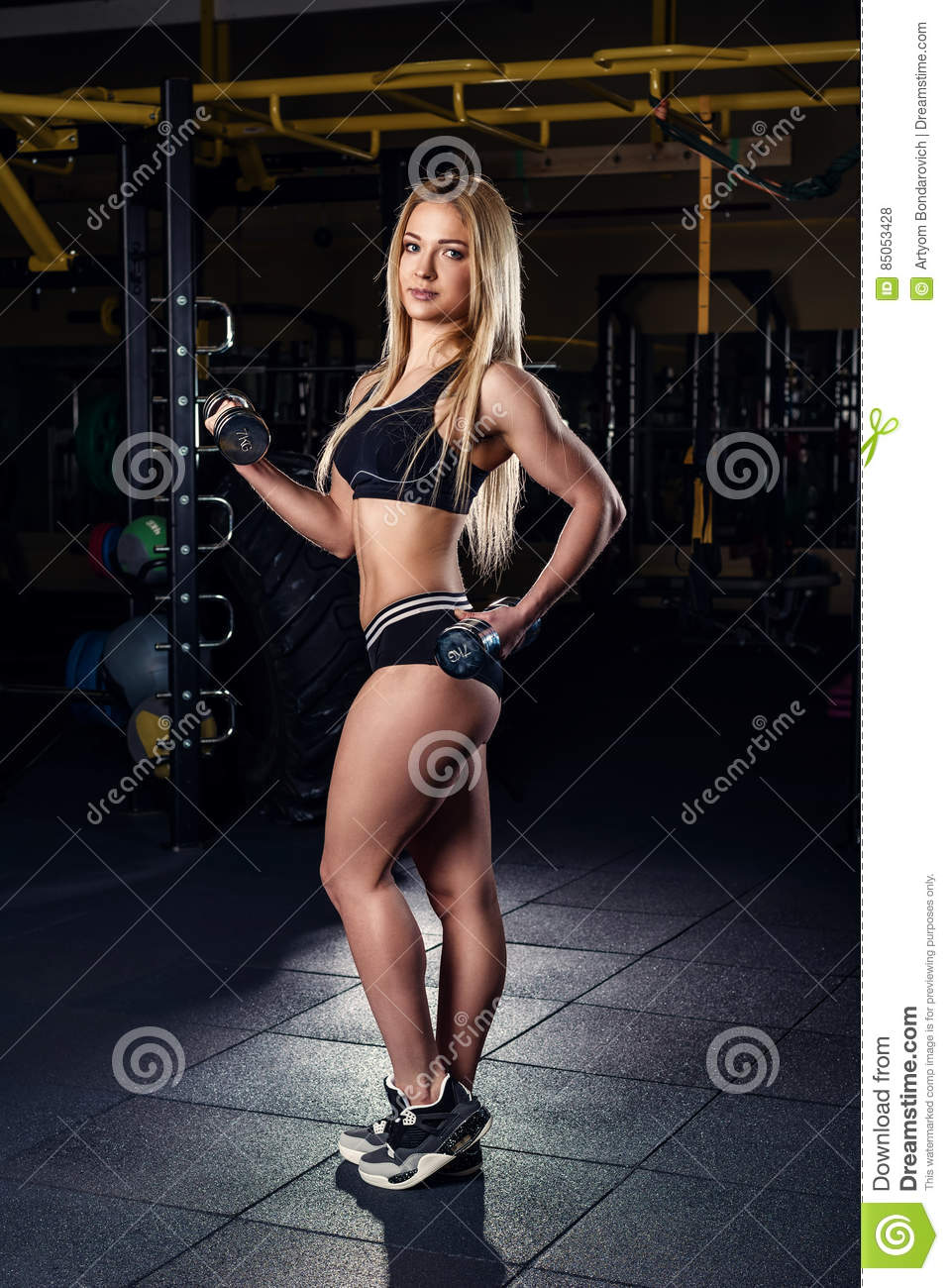 Strong Sporty Woman Bodybuilder With Tanned Body Doing