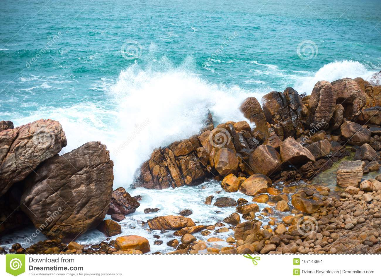 strong waves break against the rocks in the ocean colorful