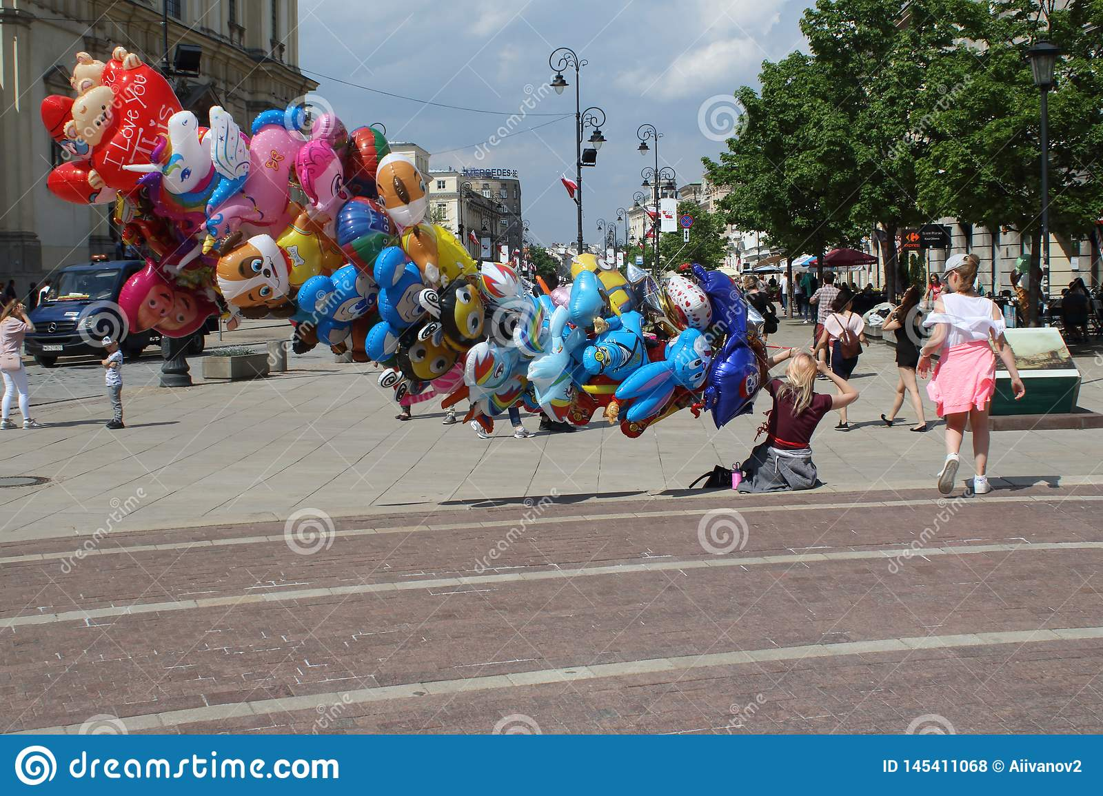 Warsaw, Poland - MAY 1, 2018: Colorful funny street Scene with ballons