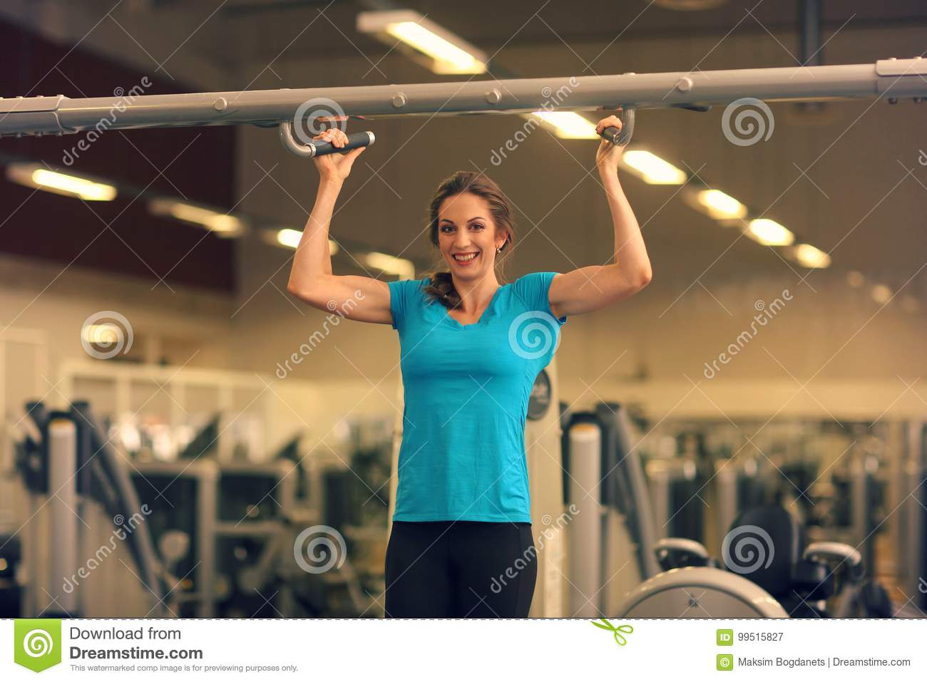 Strong Woman In Blue T-shirt And Black Pants Exercising In A