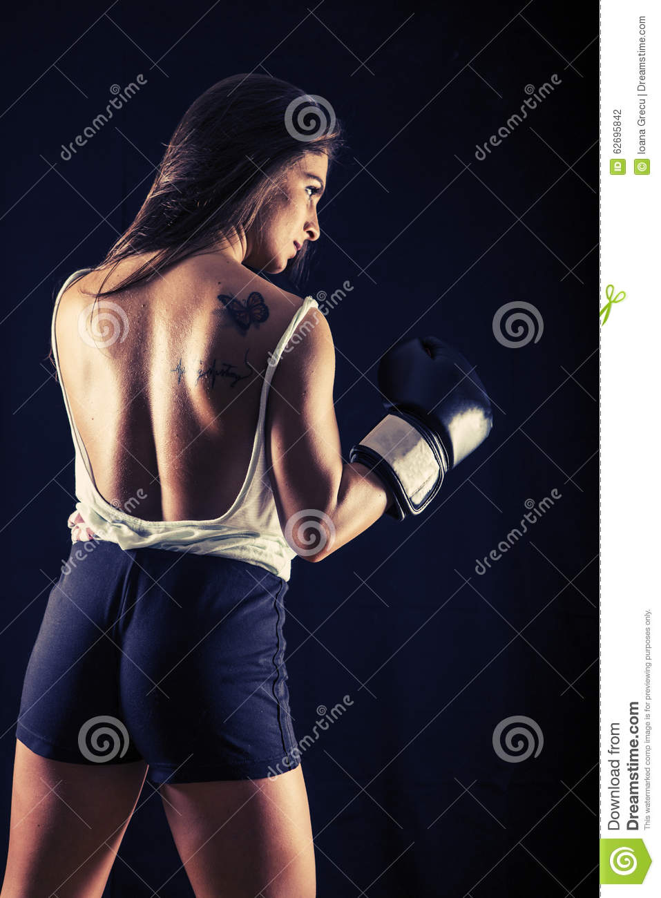 Strong young woman boxing